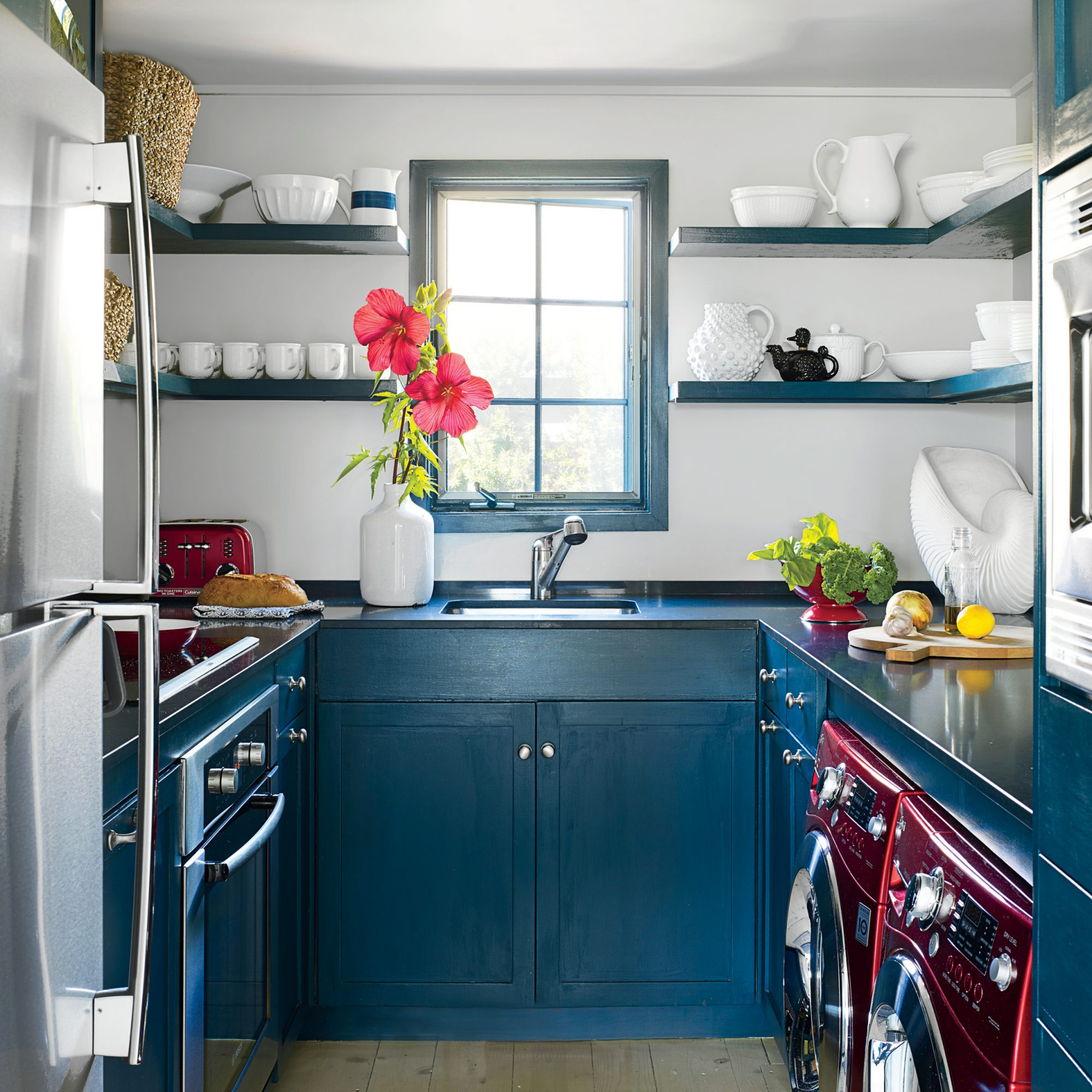 A washer and dryer in the small galley kitchen allow the room to do double duty.