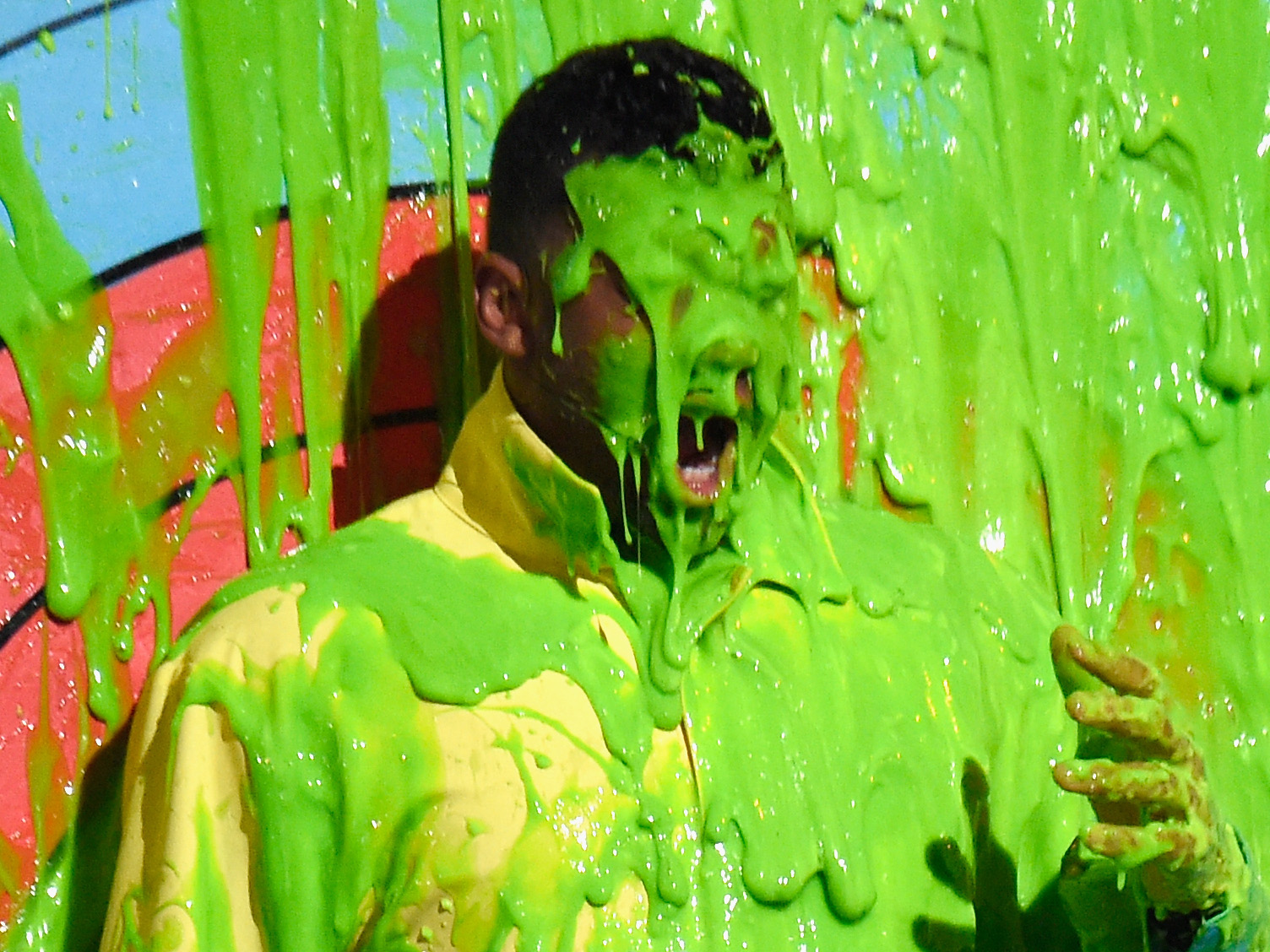 Russell Wilson gets slimed onstage