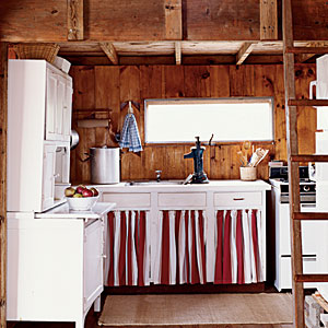 Cabinets with red-and-white skirt coverings
