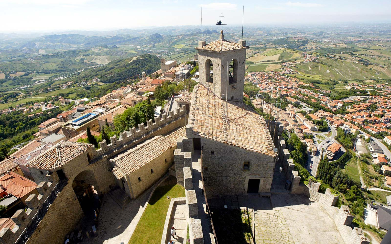 main fort, La Guaita, guarding over the walled enclosure of historic San Marino, the oldest republic in the world. Comprising only 60 square kilometres, it is therefore completely landlocked within the borders of Italy's nort