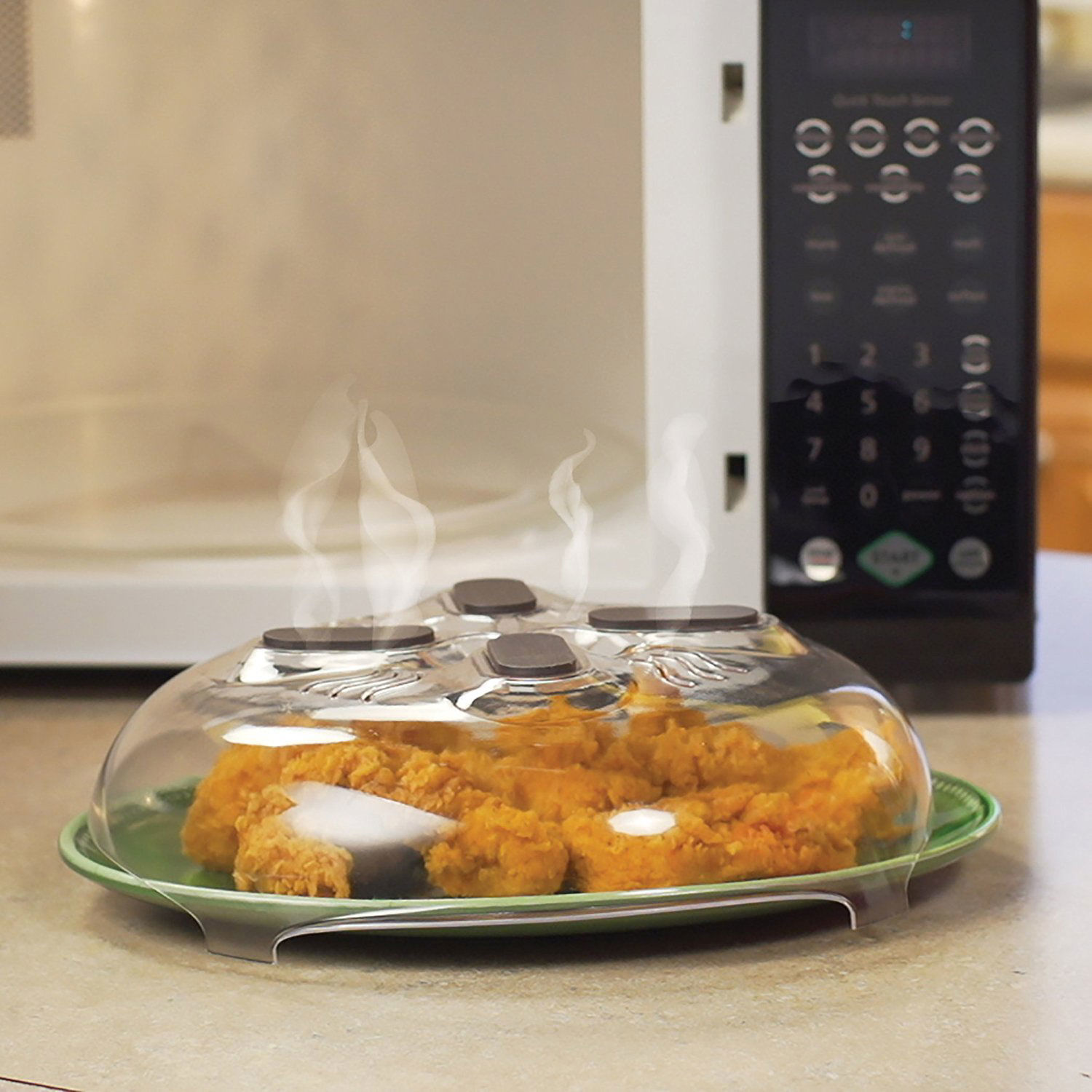 Splatter Tool in Front of Microwave