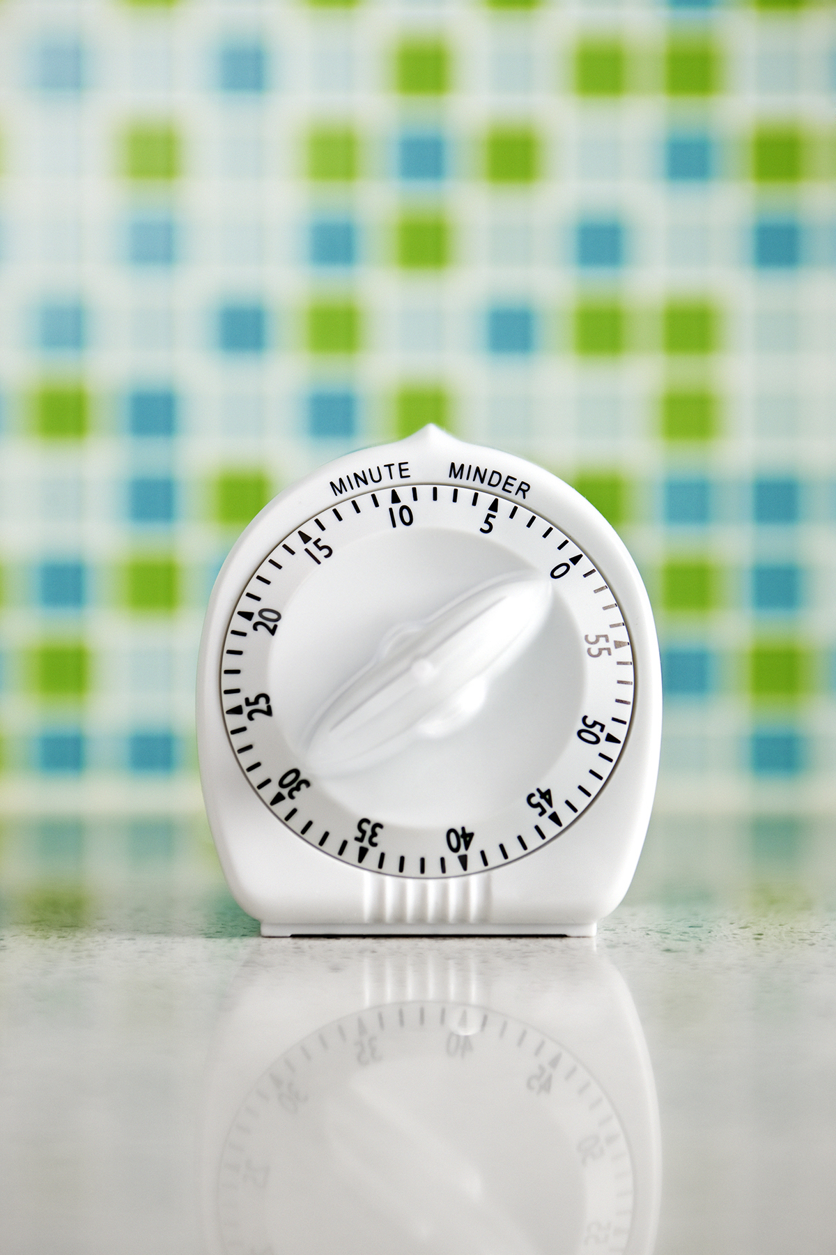 Kitchen timer with blue and green tiles