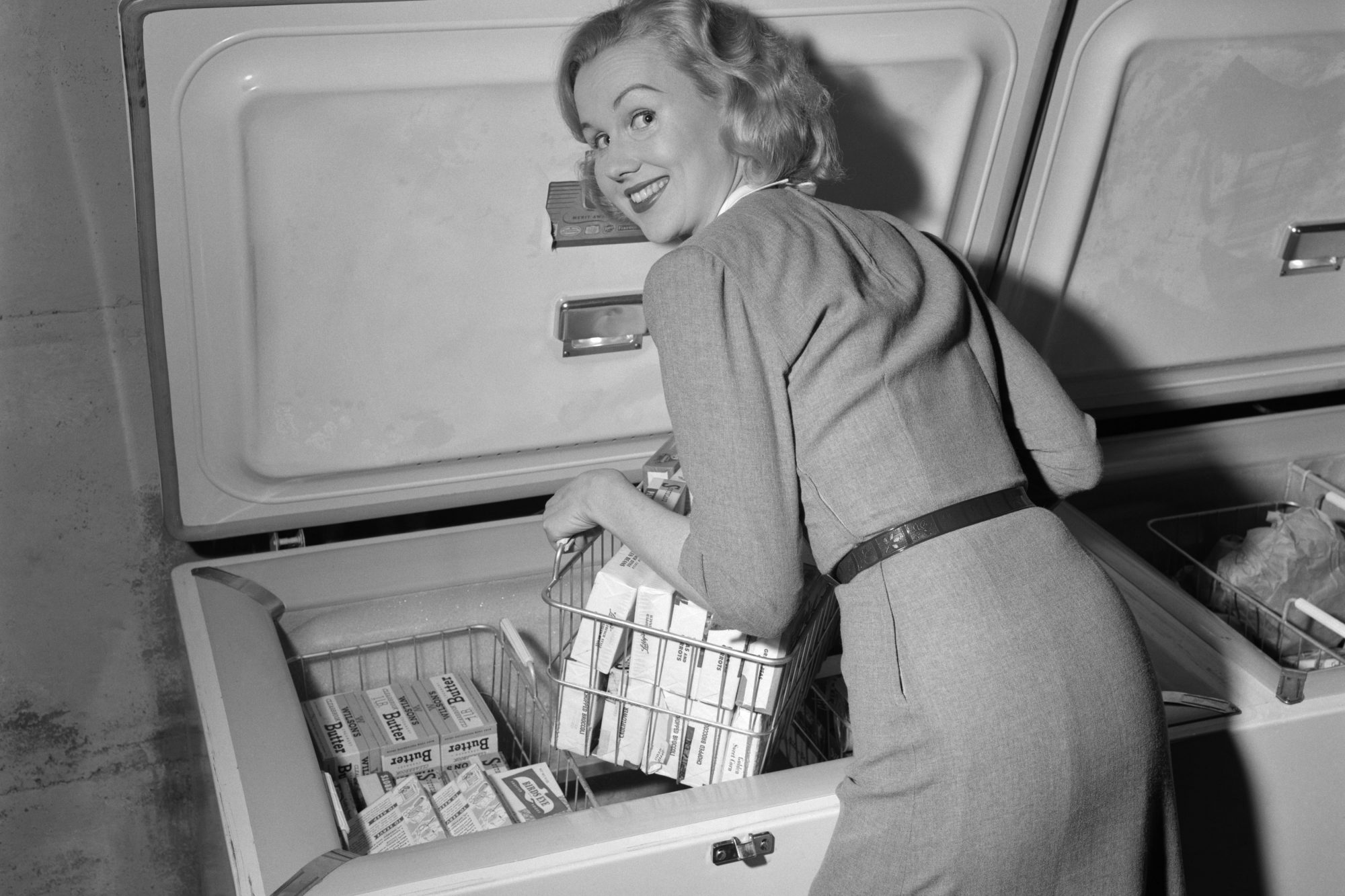 Woman Reaching in Freezer