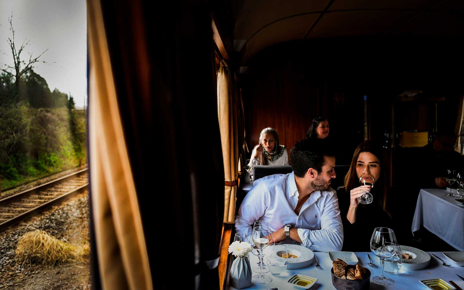 A couple have a meal aboard the Presidential Train during its trip to Douro, north of Portugal, on April 8, 2018.