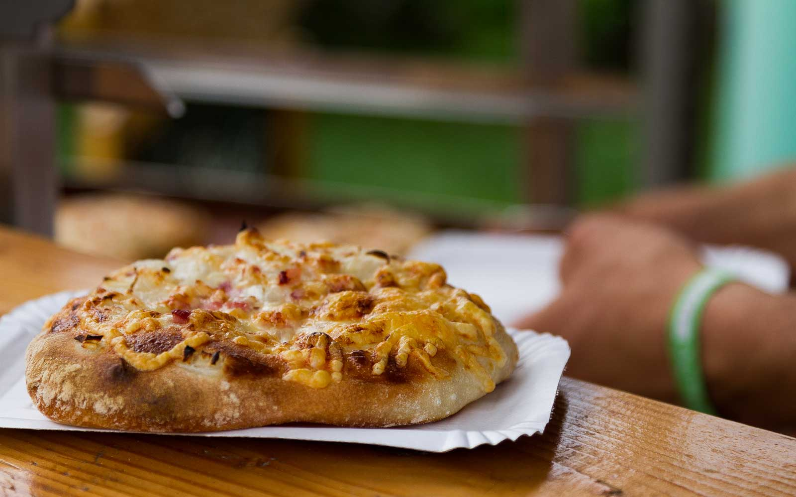 This Hungarian-style pizza is typically topped with bacon, onion, and cream.