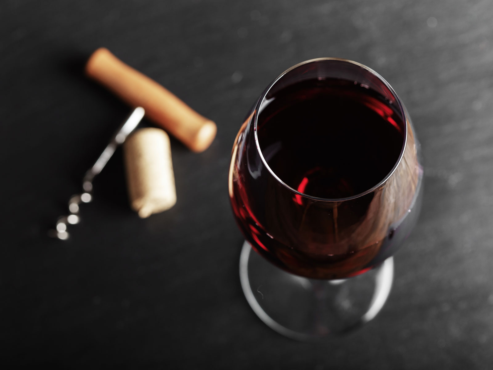 Red wine with corkscrew