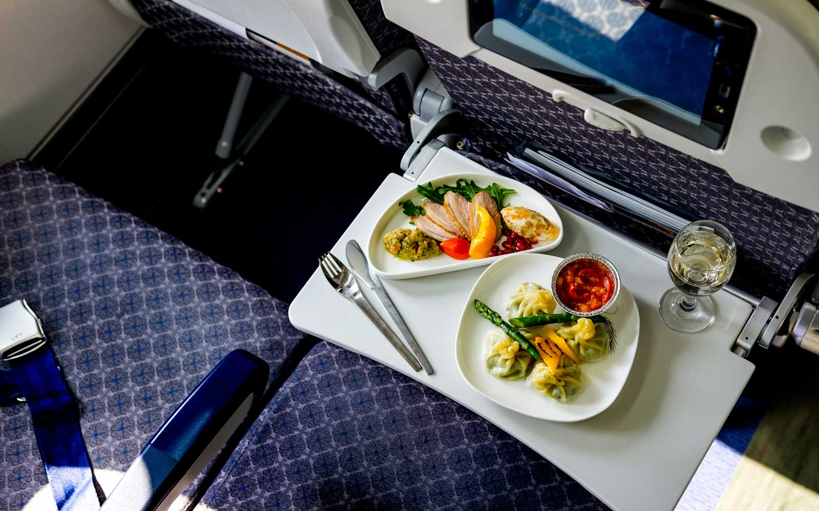 Meal on airplane food tray table