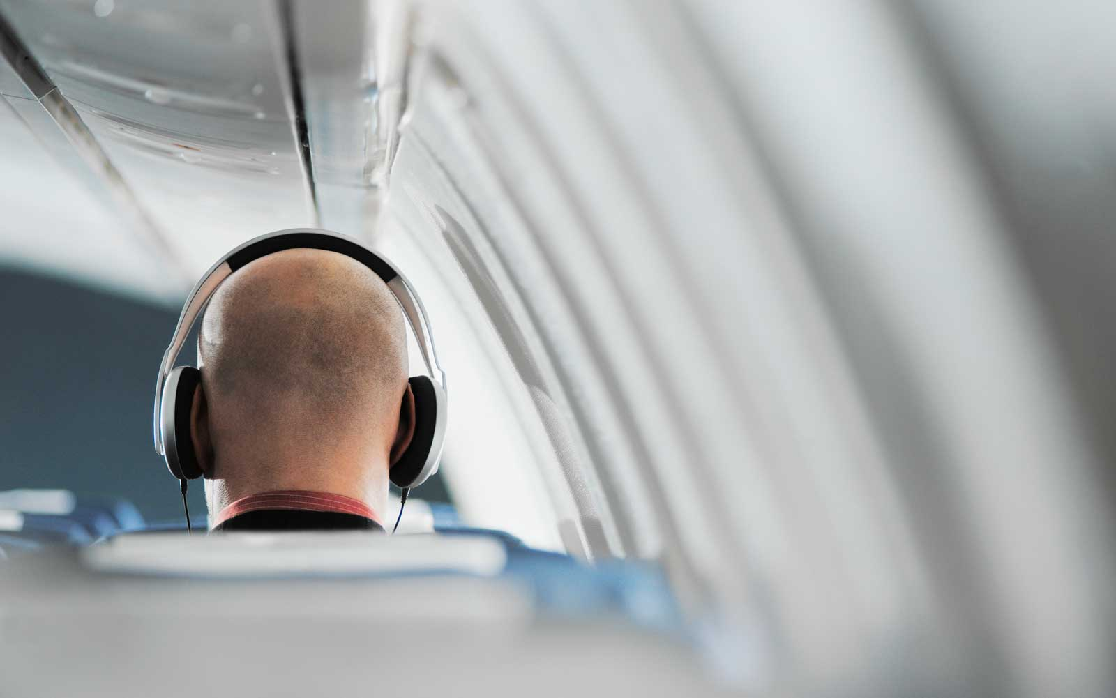 Airline passenger wearing headphones