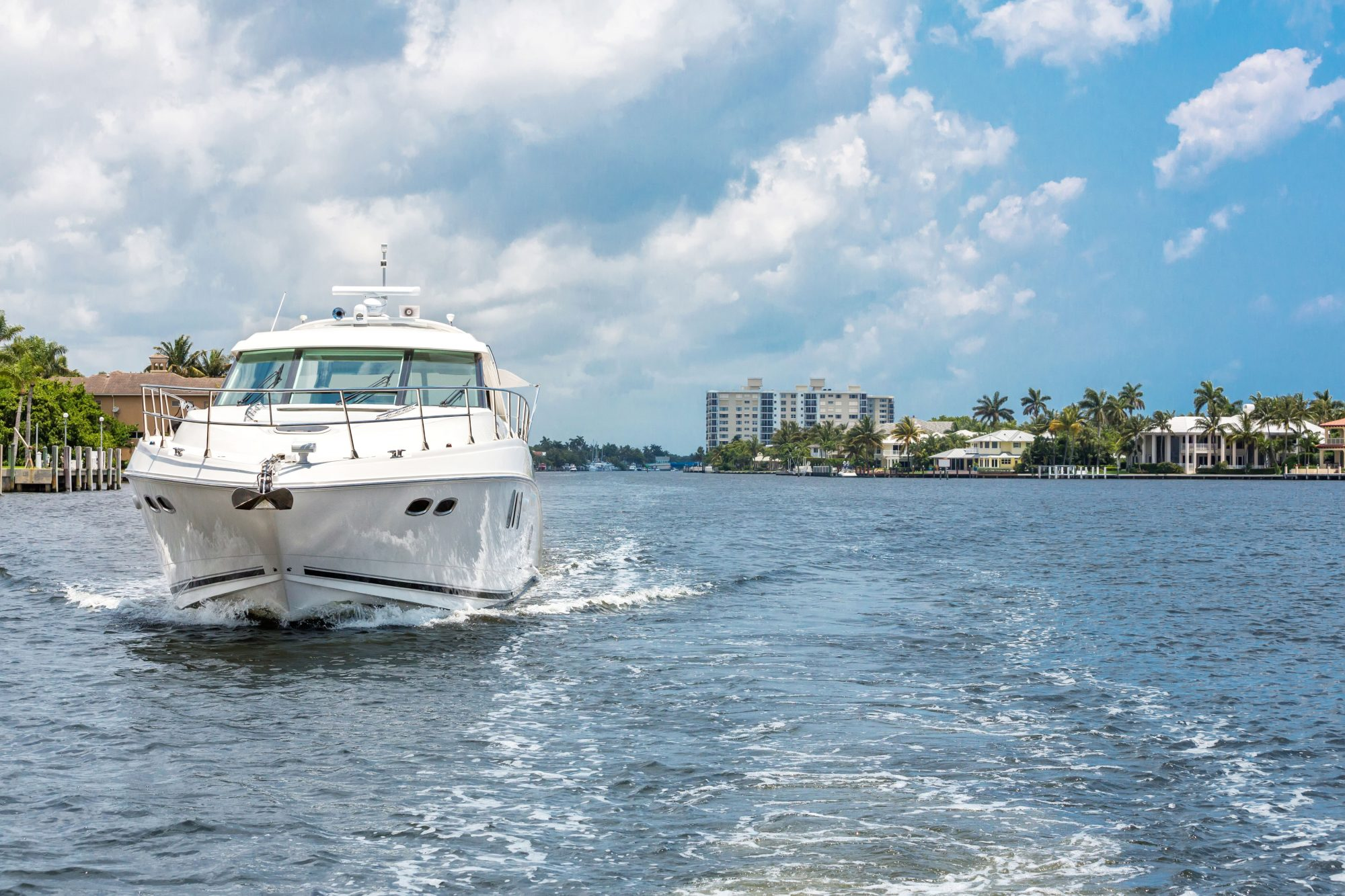 A large boat moves along the Florida Intracoastal Waterway.