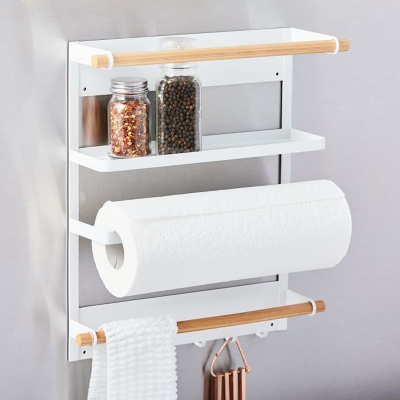 White and wood magnetic storage rack on refrigerator