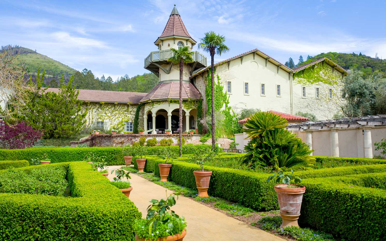 Formal gardens and architecture at Chateau St Jean vineyard in Sonoma County, Kenwood, California
