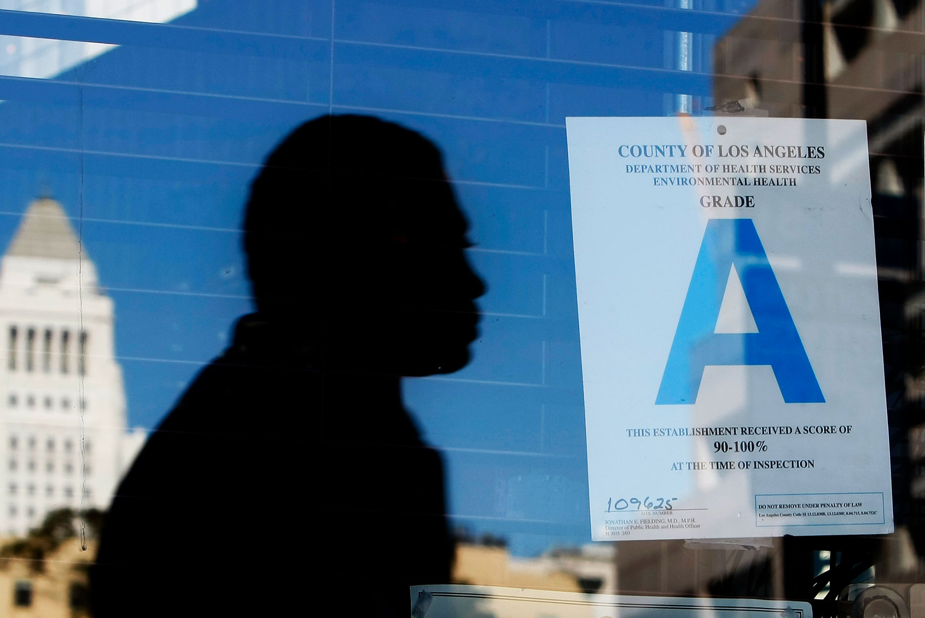 A health grade appears on a restaurant window in Los Angeles