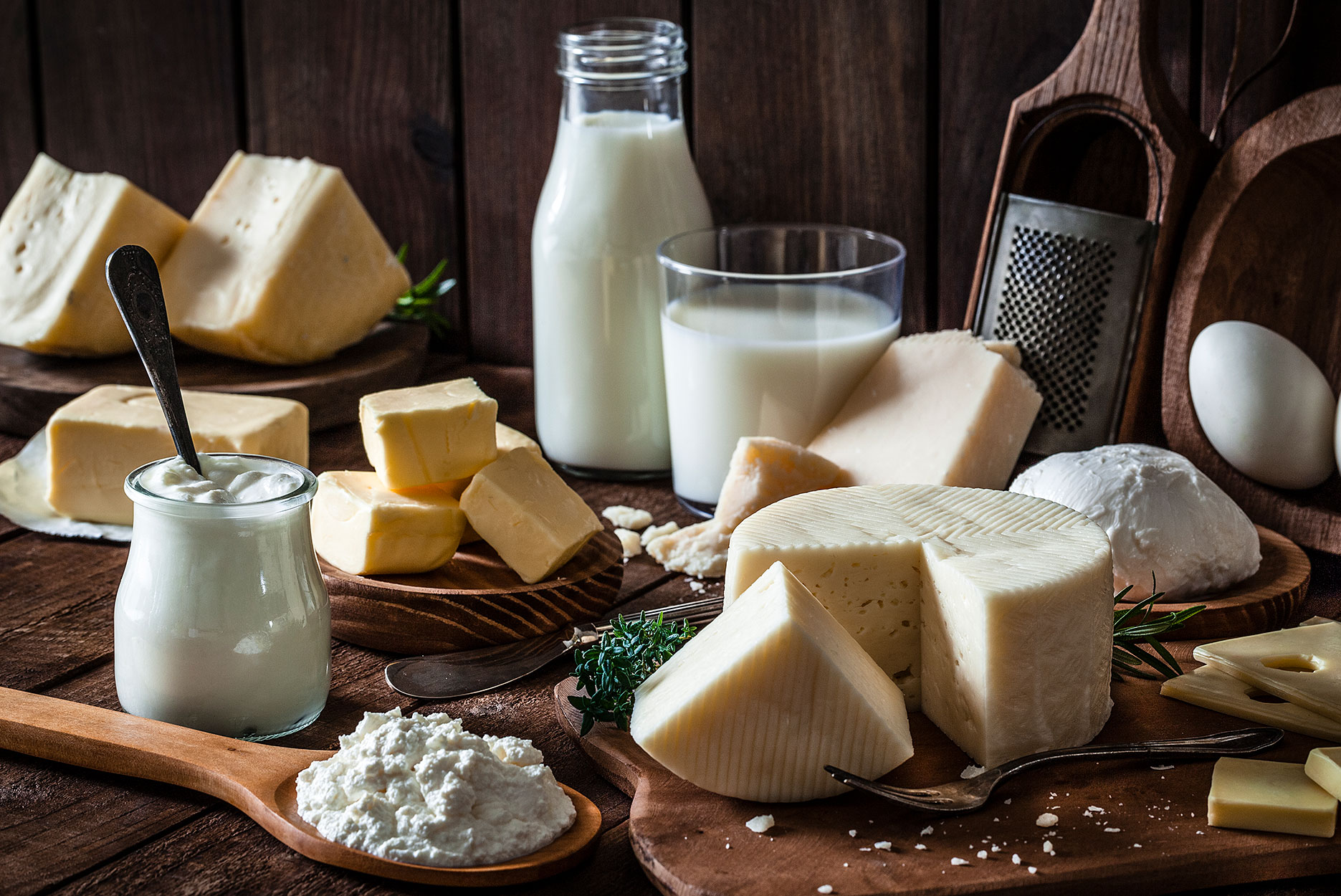 Dairy products assortment shot on rustic wooden table