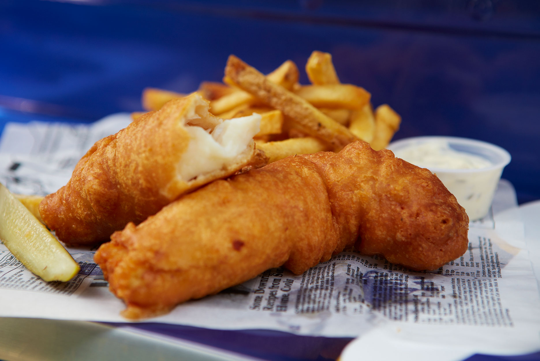 two pieces of fish and chips on a food truck