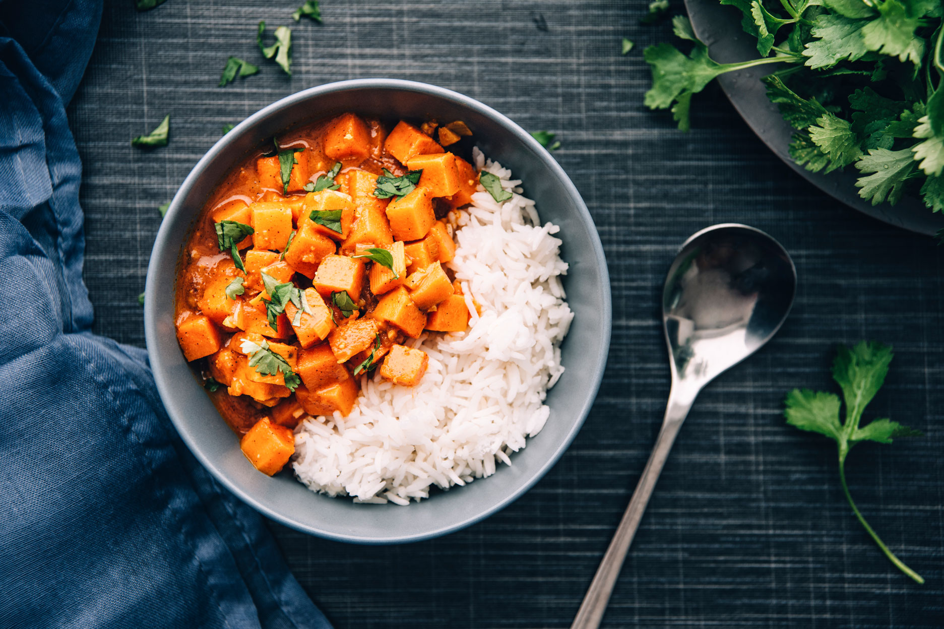 Sweetpotato ragout (vegan) with tomato,cocconut milk,roasted peanuts,garlic,ginger,cilantro, served with rice