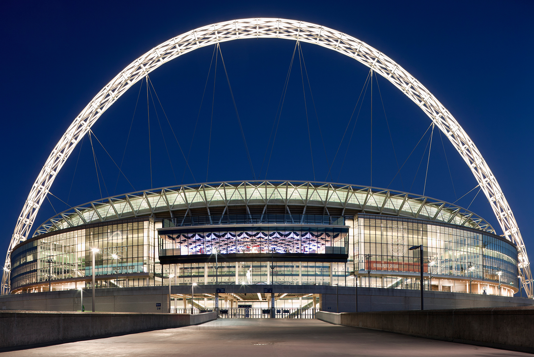 Wembley Stadium and statue of Bobby Moore at night