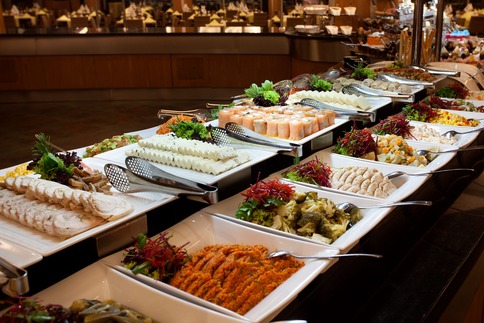 Luxury Buffet in a hotel restaurant. Focus on sushi.