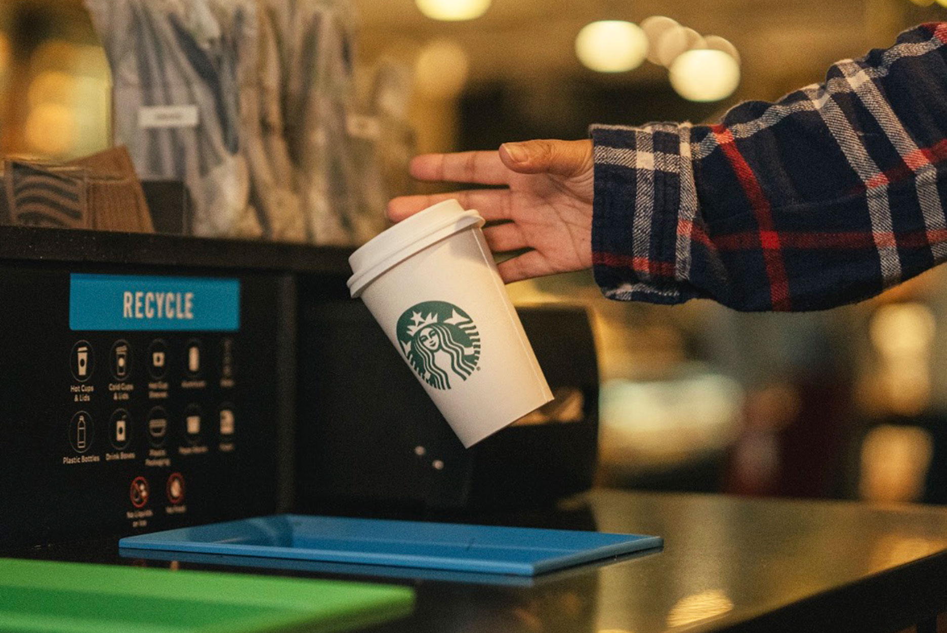 A customer recycles the new nextgen cup from Starbucks