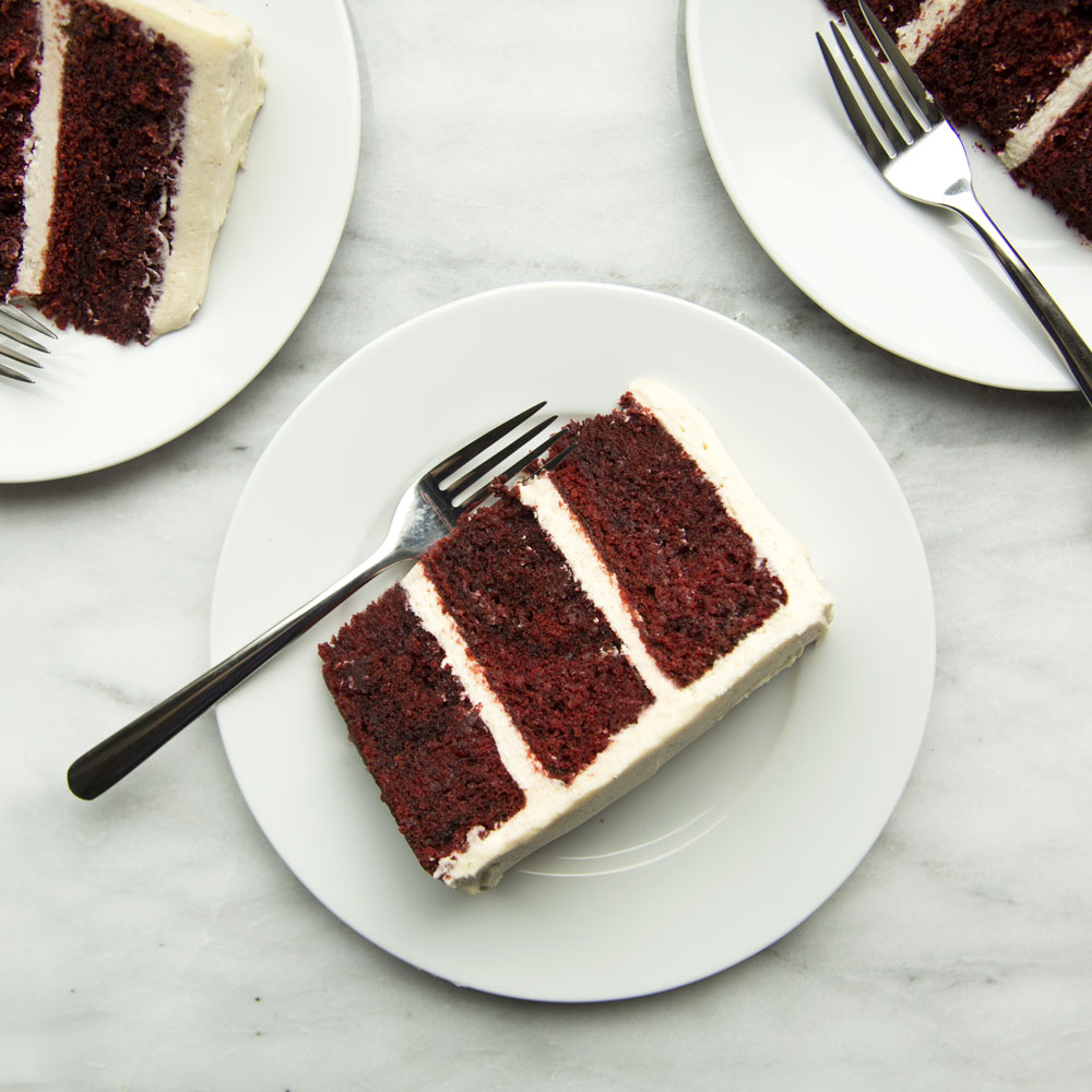 This towering cake is made with deep red cake layers and lots of cream cheese frosting. Unsweetened cocoa powder and red food coloring give the cake its signature hue.