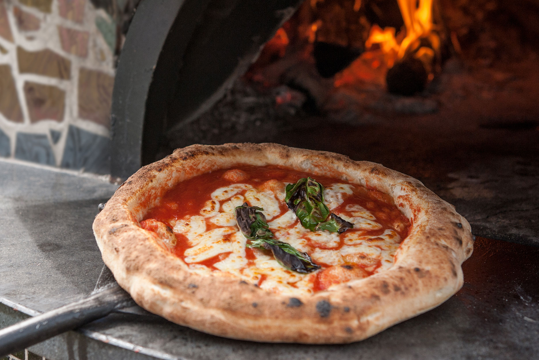 Italian traditional pizza Margherita baked in the wood-fired oven