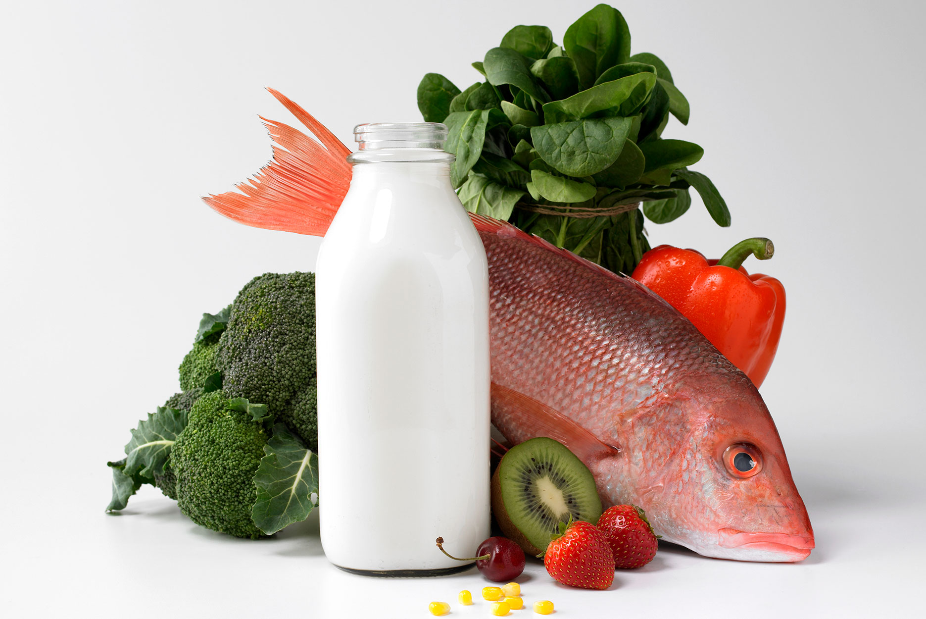 Bottle of milk, fish, fruits and vegetables.