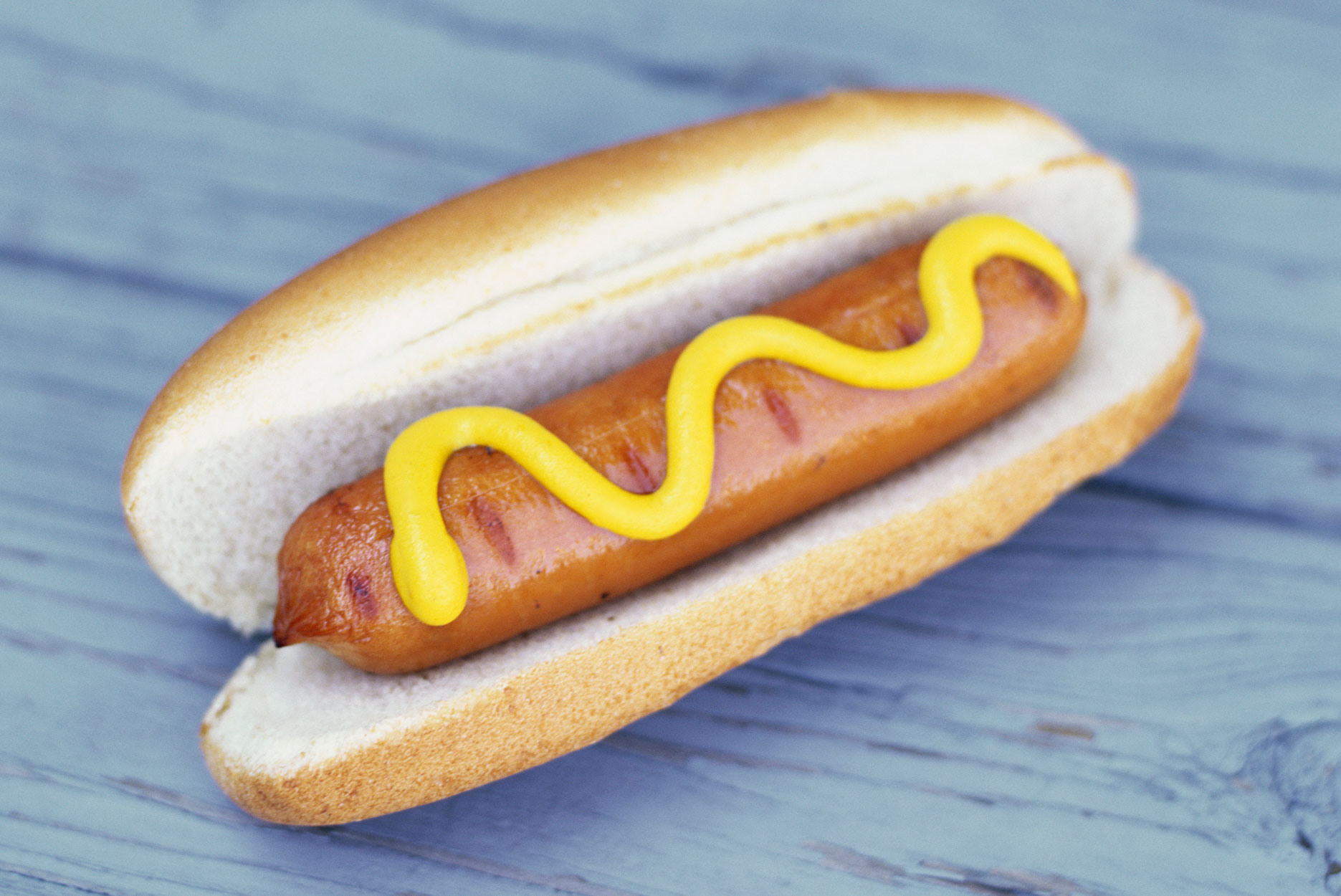 Hot-dog on blue wood background