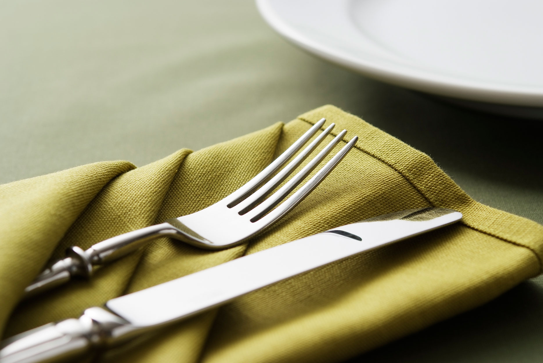 Close-up shot of green table setting with copy space