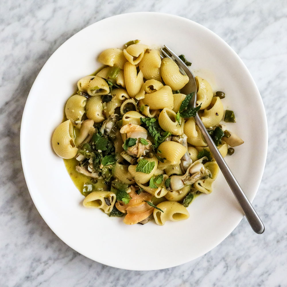 At Chicago's Roister restaurant, chef Andrew Brochu puts a delicious spin on classic pasta with clam sauce, adding a spicy green chile ragout, fresh herbs, crème fraîche and lime juice.