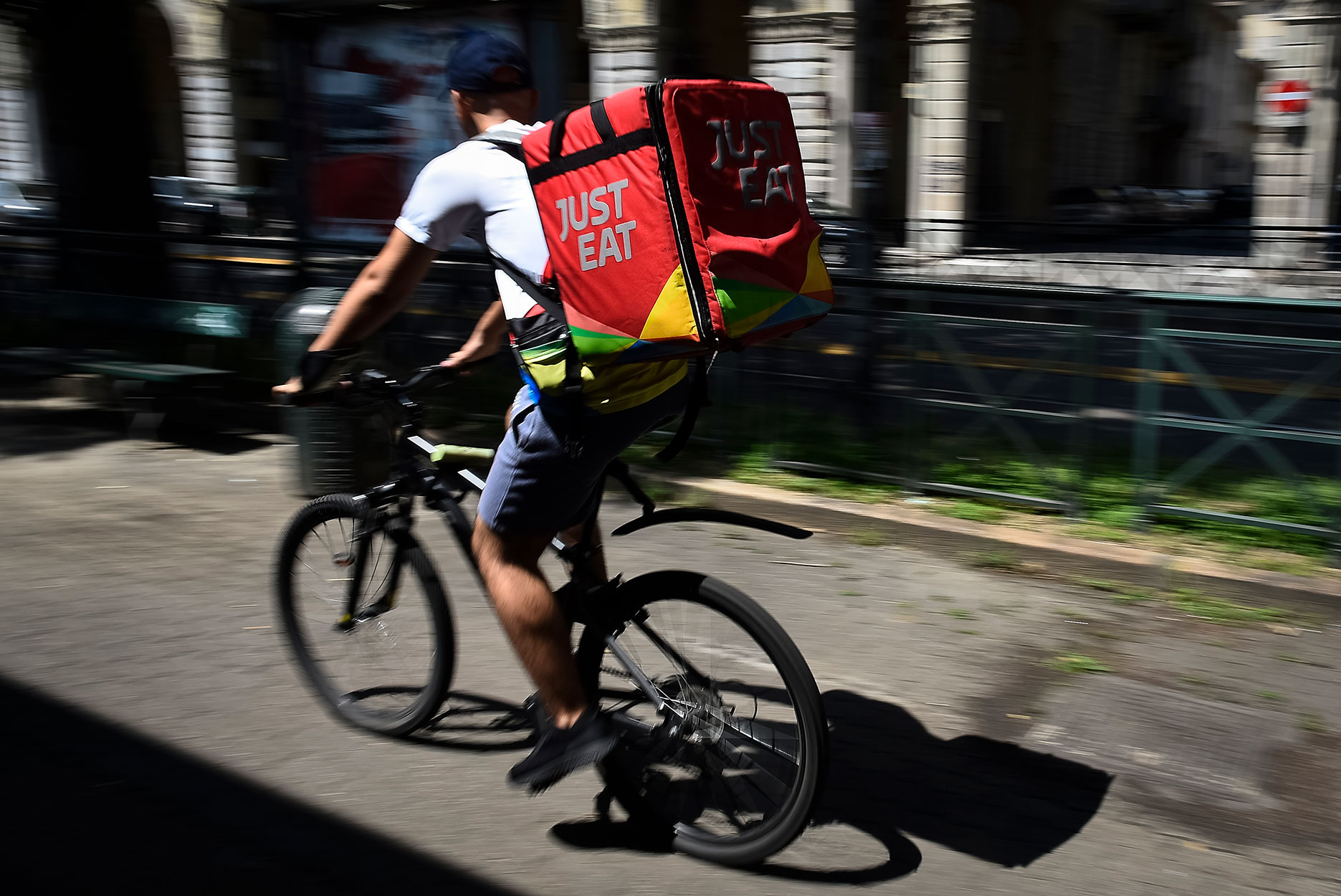 A Just Eat courier rides during his work. Just Eat is a