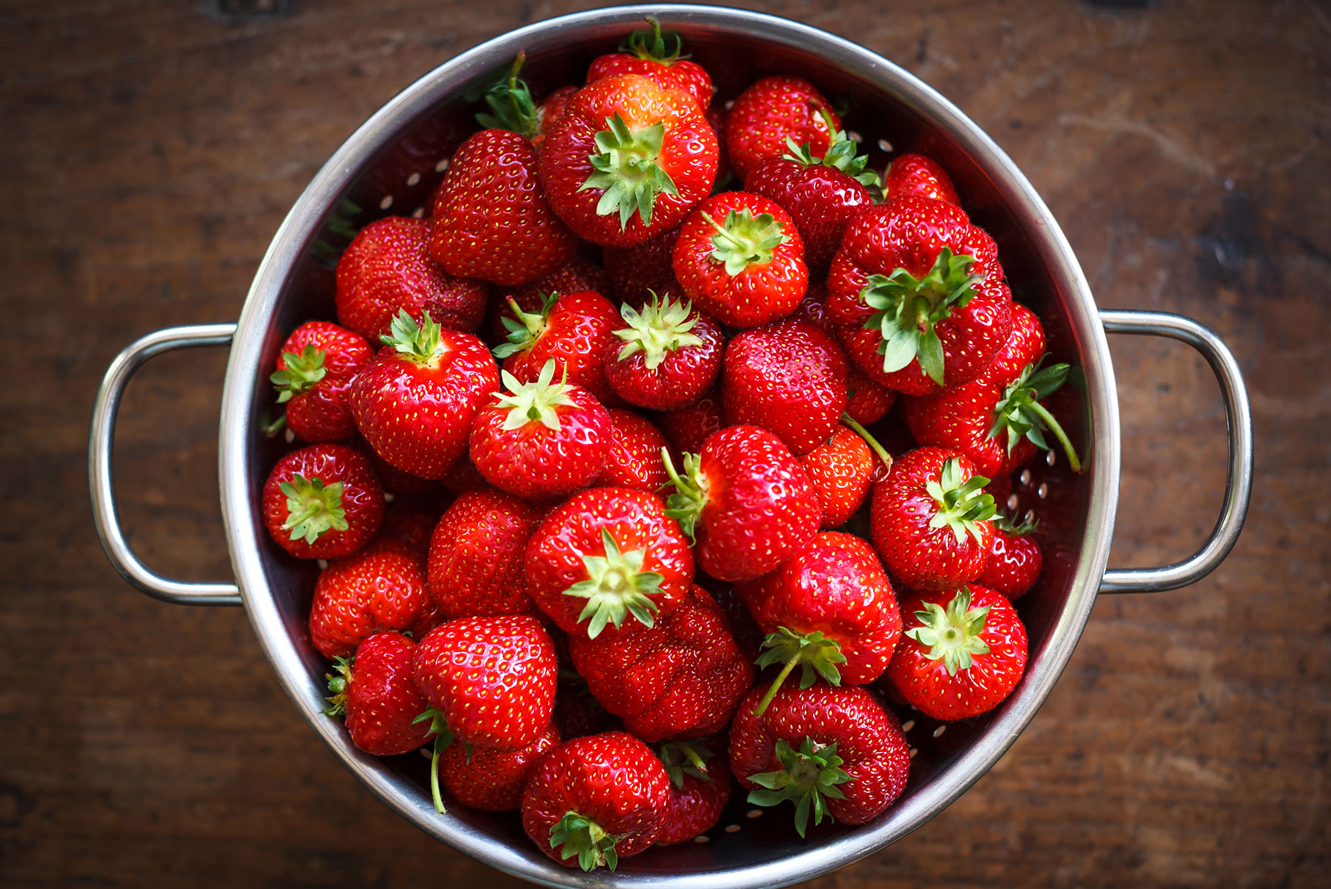 Colander full of ripe strawberries