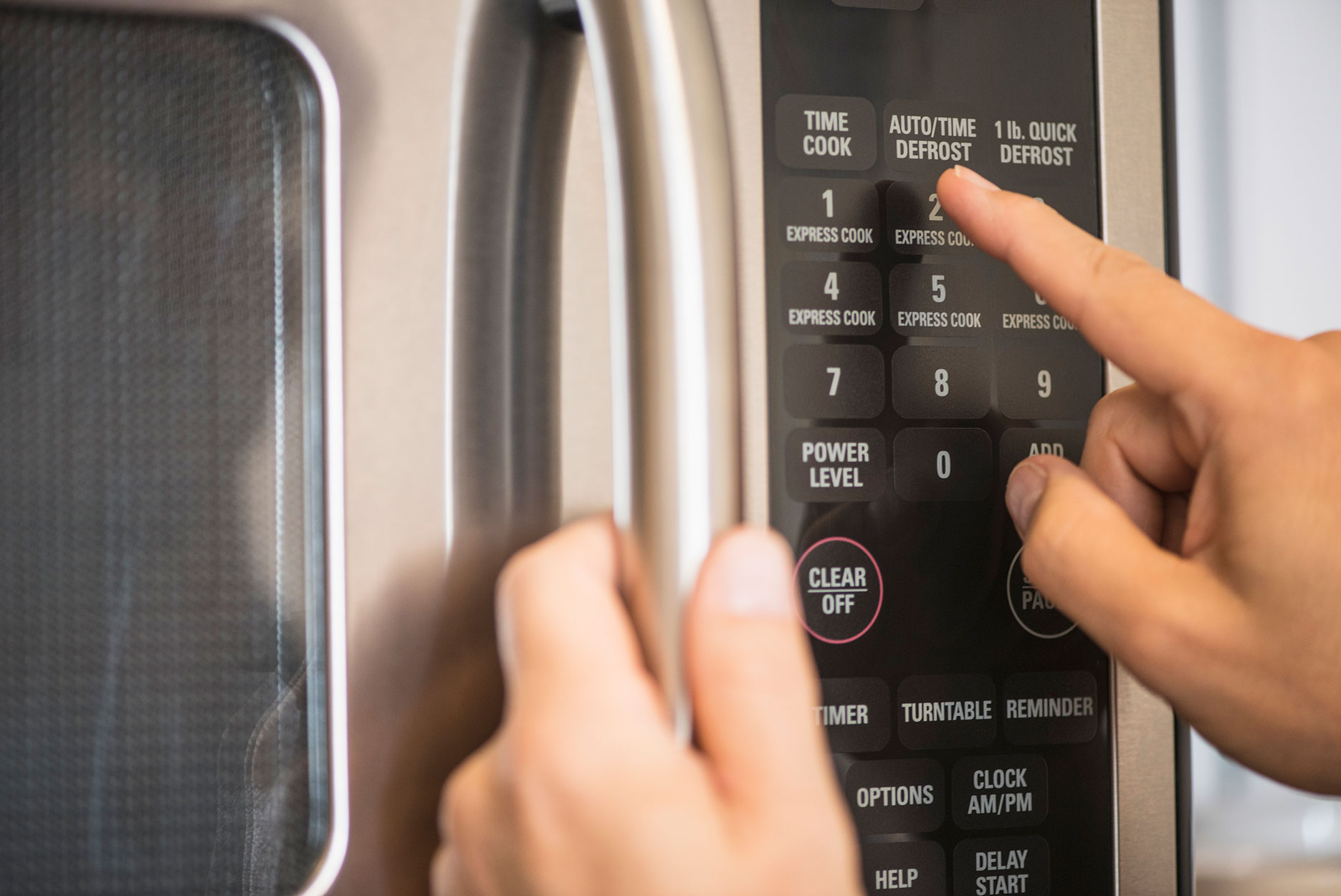 pressing microwave buttons