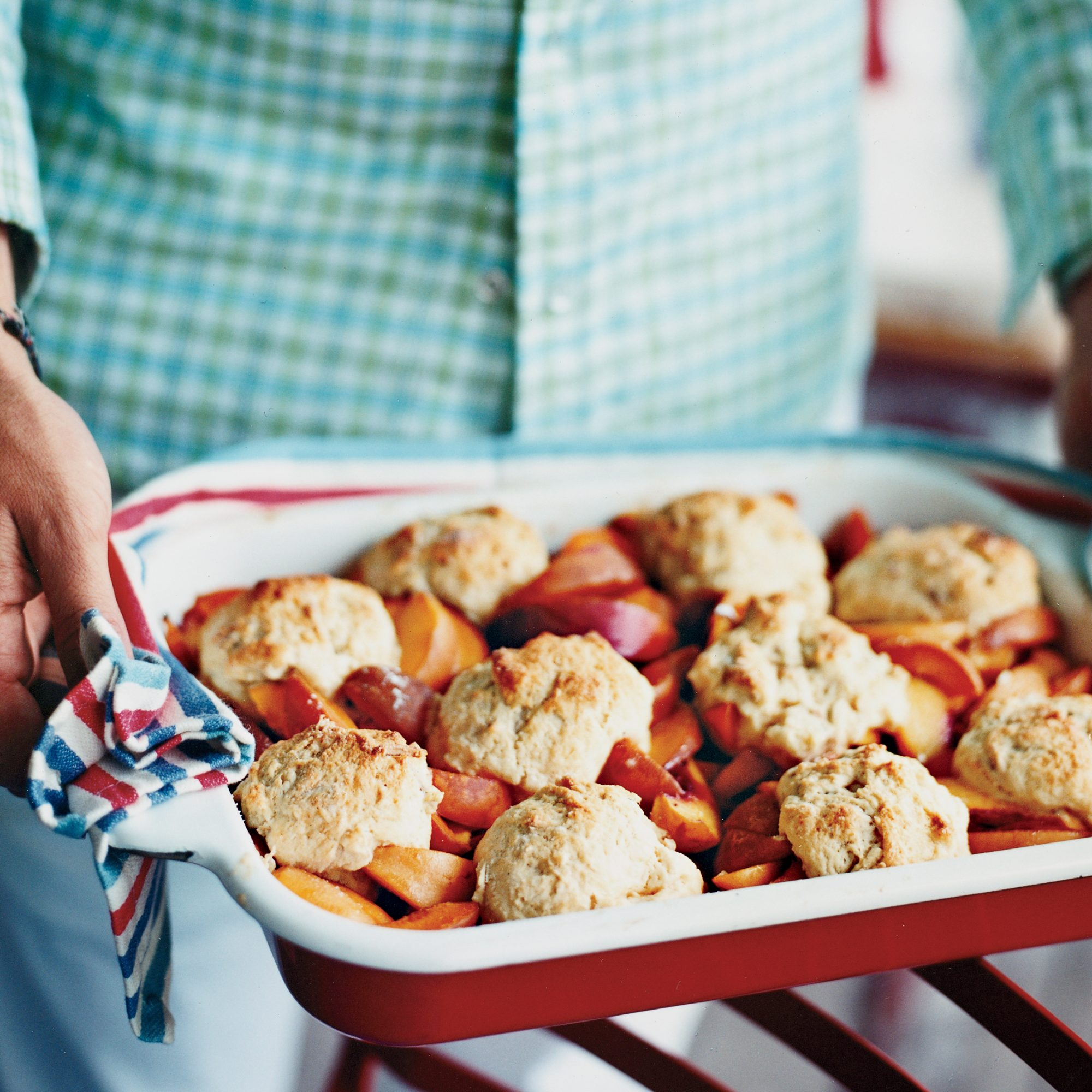 To boost the almond flavor in this recipe, Laurent Tourondel folds a handful of toasted slivered almonds into the fluffy, sweet cobbler topping.