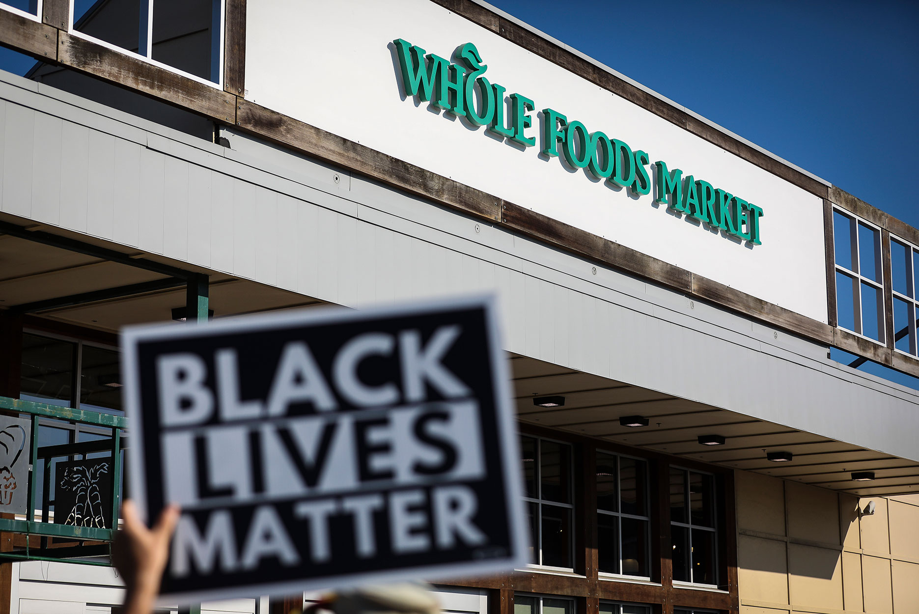 Demonstrators Protest Whole Foods For Dismissing Employees Wearing BLM Masks