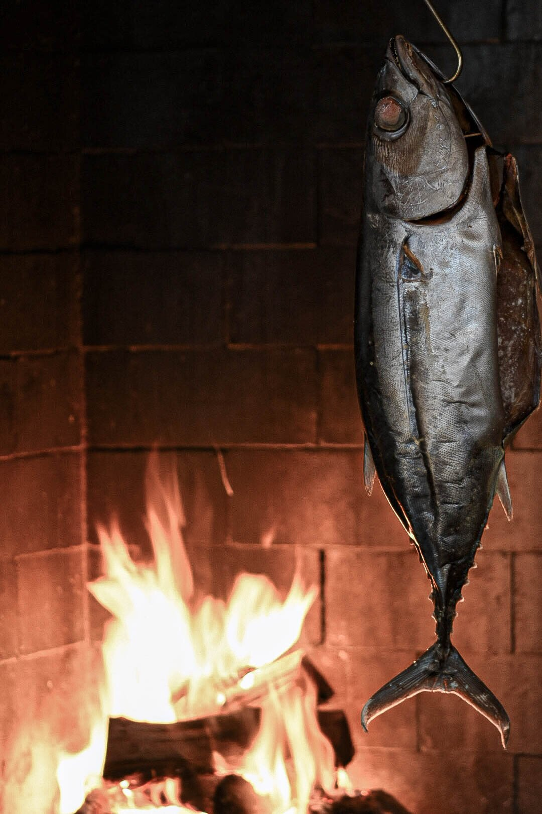 Whole Fish cooking over an open fire at Pasture