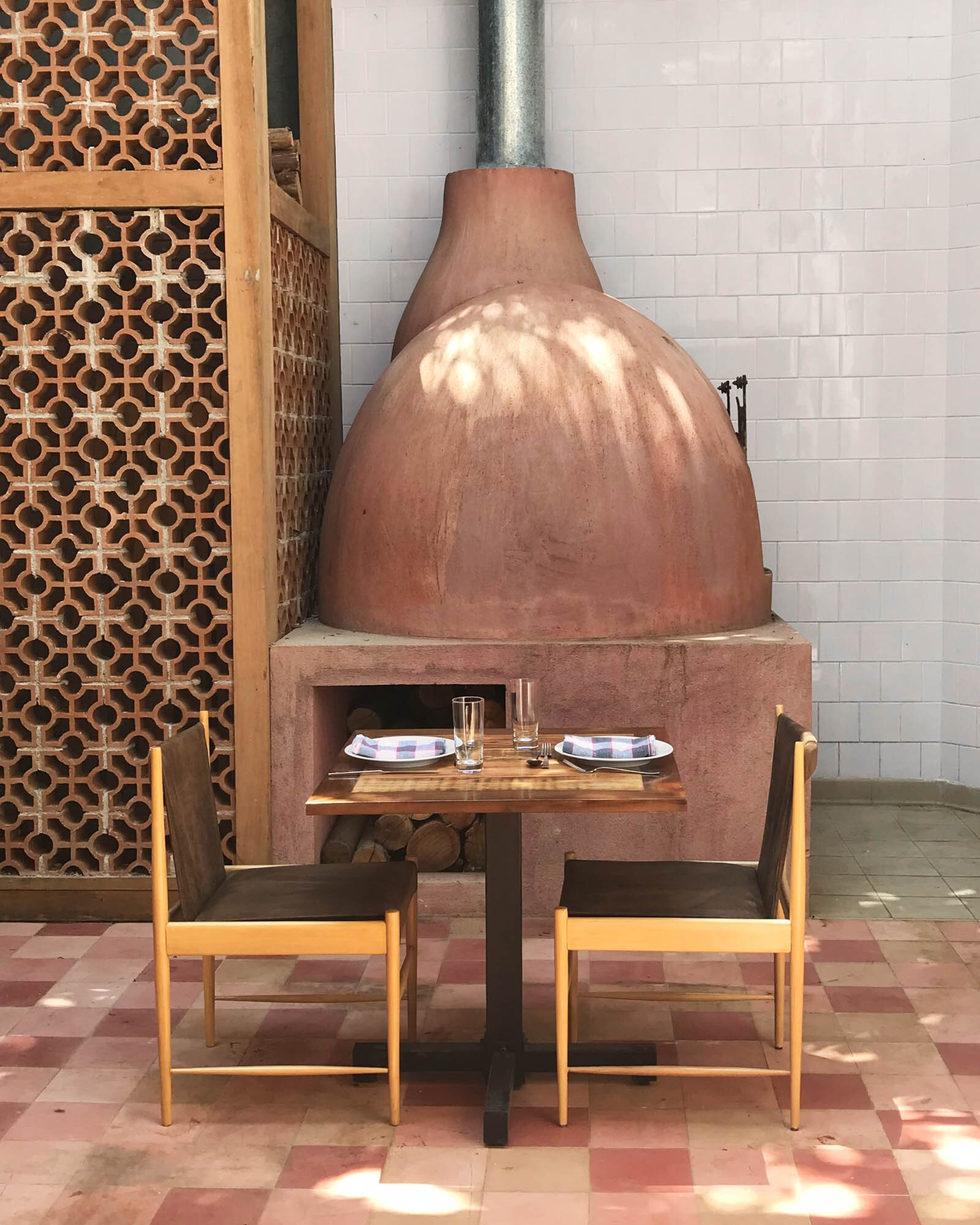 At Sud in Rio de Janeiro, a wood-fired oven informs a rustic menu in a small, cozy dining room.