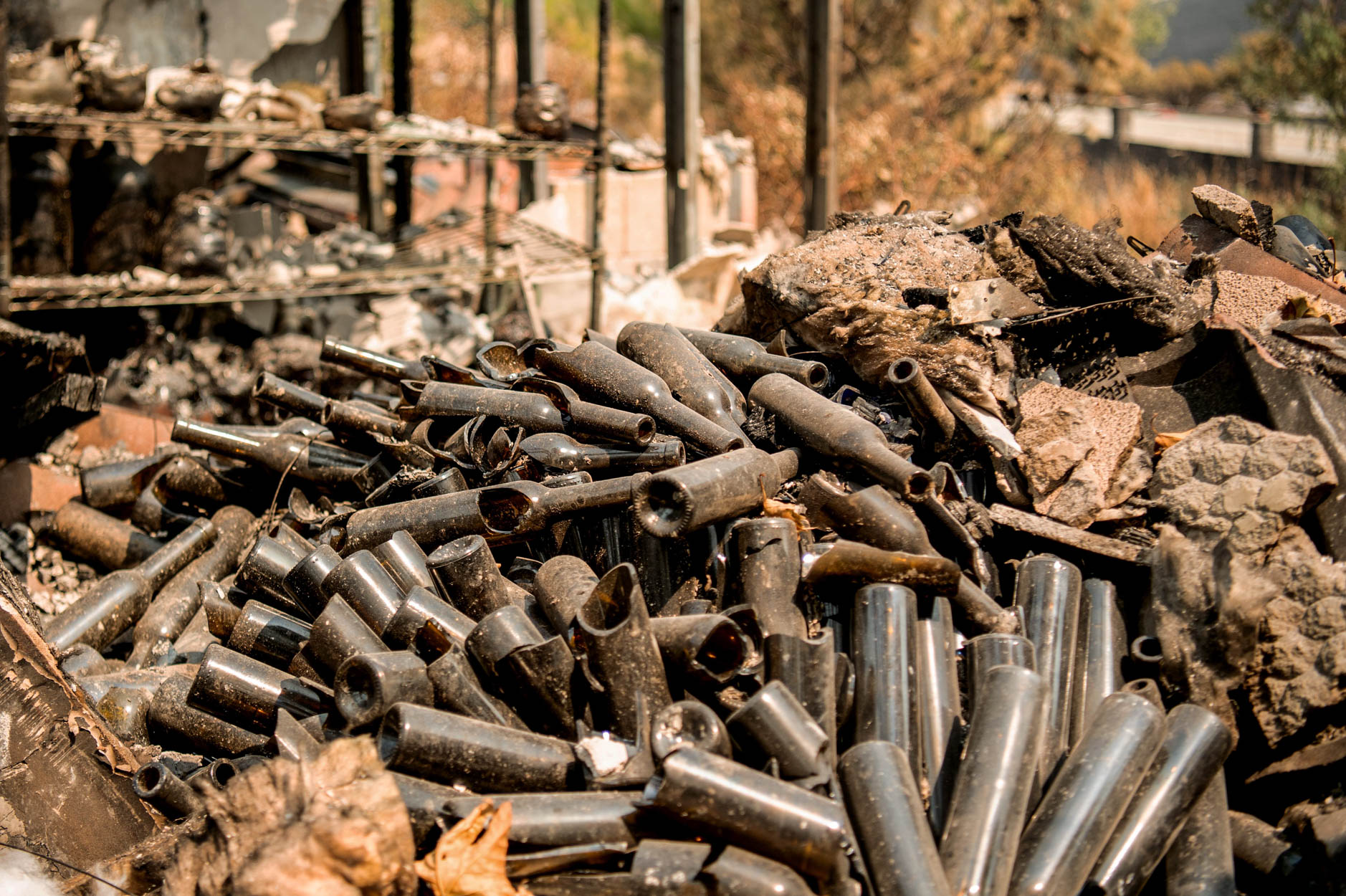 Burned wine bottles sit amidst charred remains at La Borgata Winery during the LNU Lightning Complex fire in Vacaville, California on August 23, 2020.