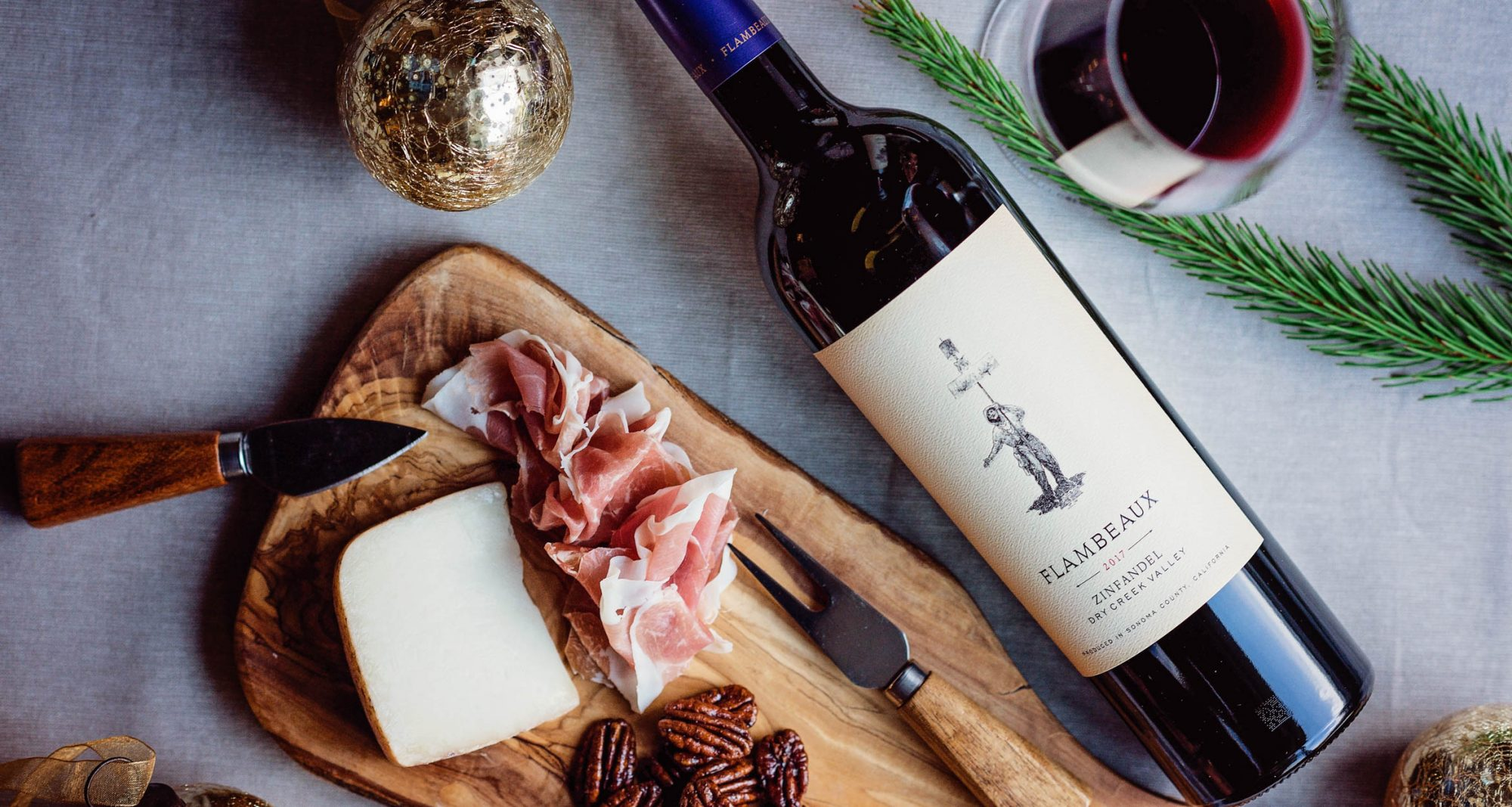 Charcuterie and Cheese alongside a bottle of Flambeaux Zinfandel