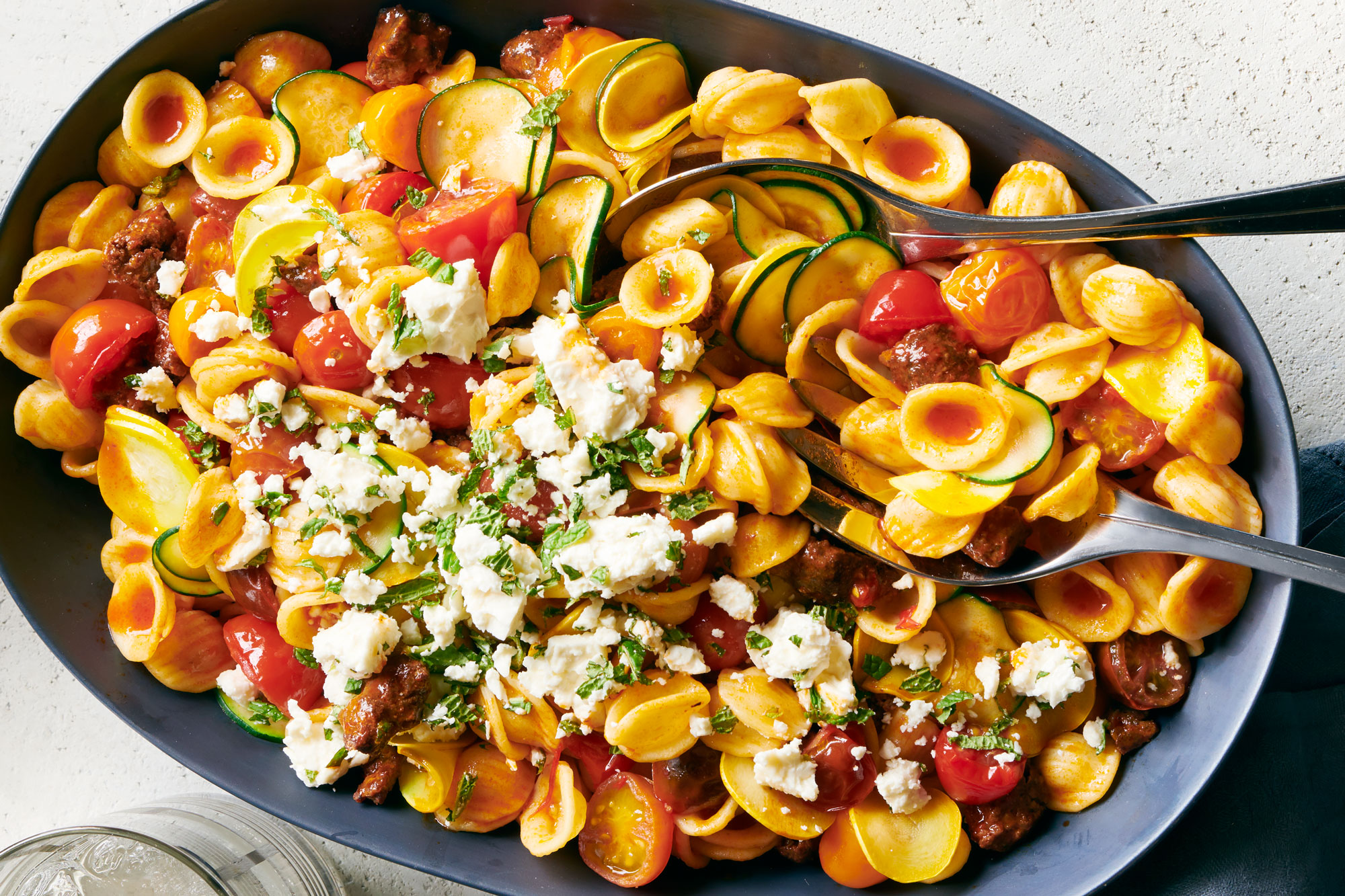 Spicy Sausage Pasta with Tomatoes and Squash