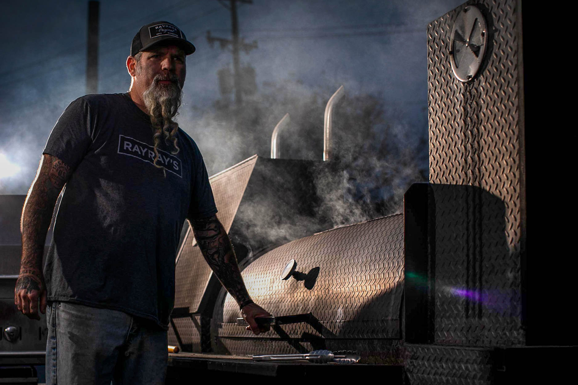 Ray Ray's Hog Pit owner James Anderson at the smoker