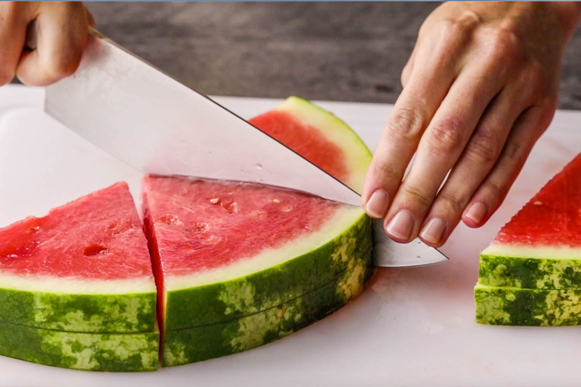 Cutting a watermelon into wedges