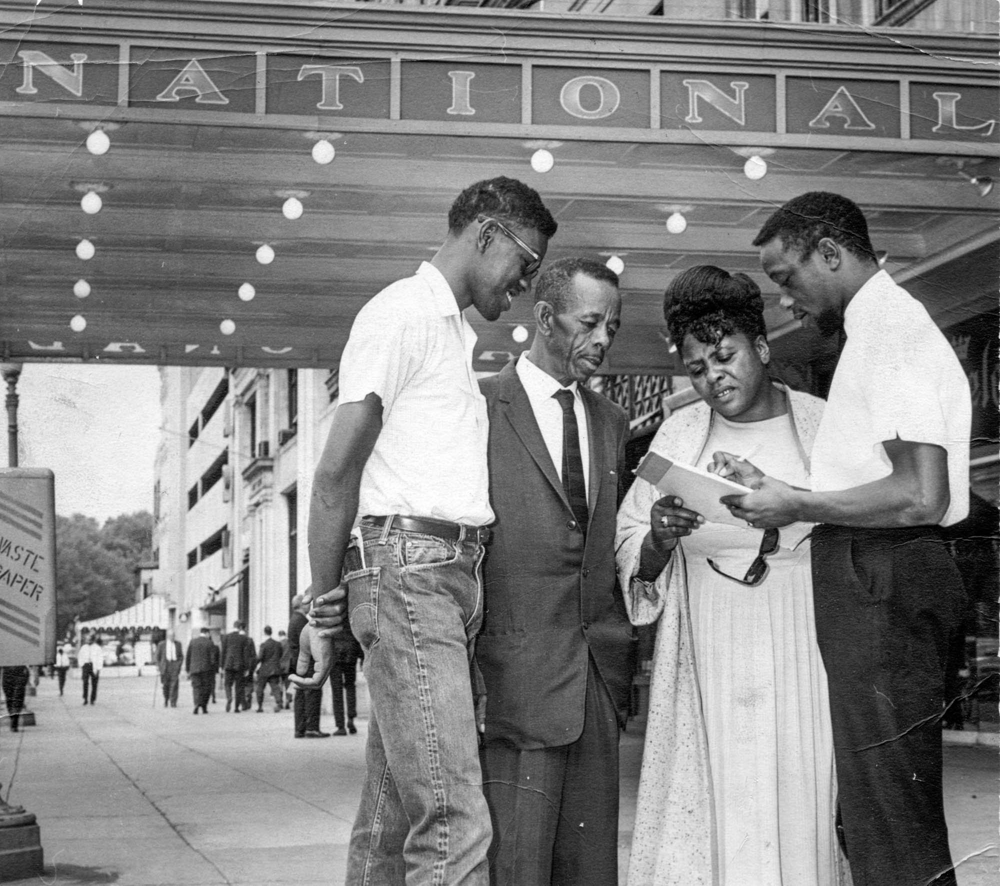 Fannie Lou Hamer standing with three men, June 16, 1964