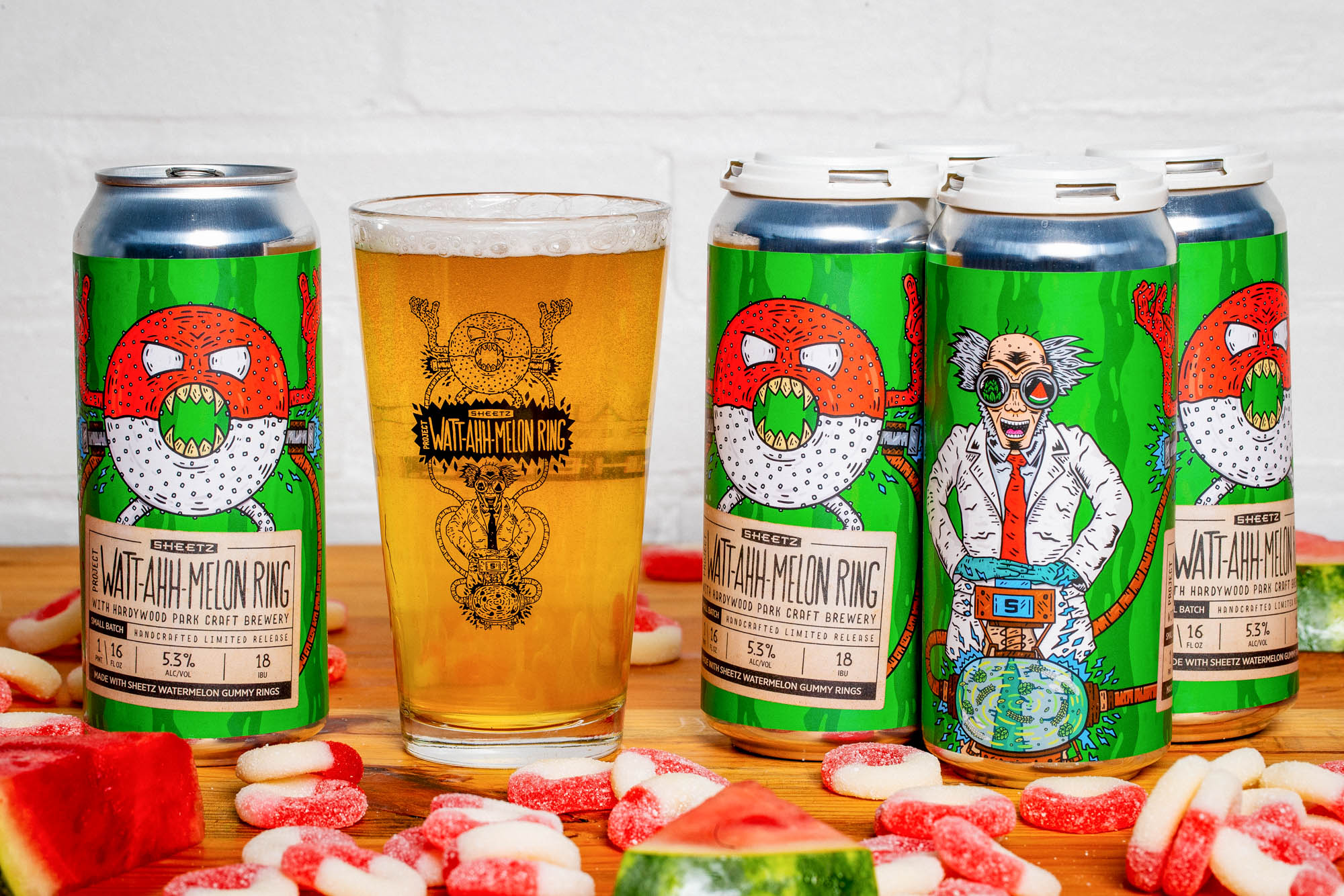 Cans and glass of Sheetz Watt-ahh-melon ring surrounded by watermelon ring candies