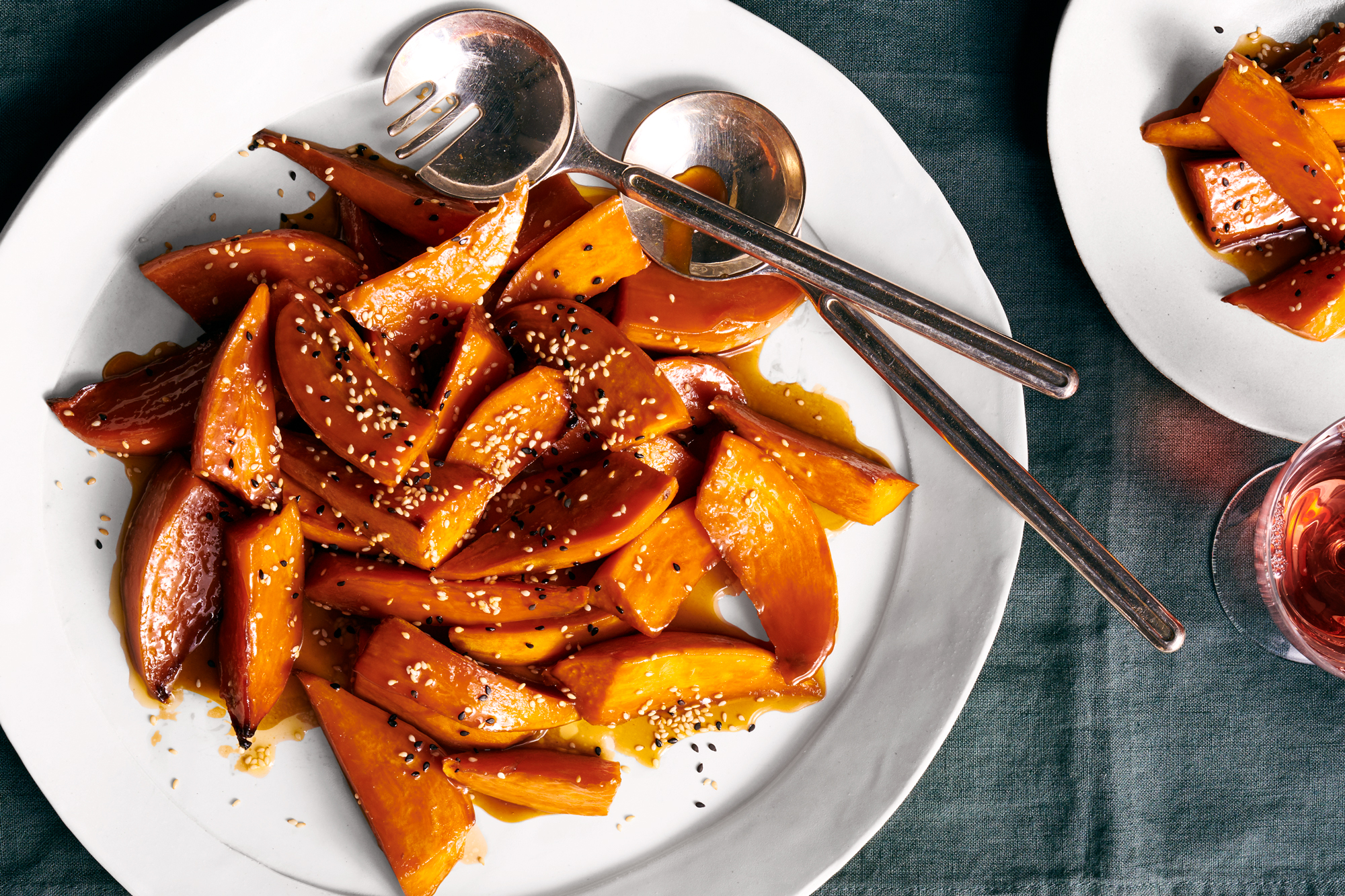 Glazed sweet potatoes with sesame seeds