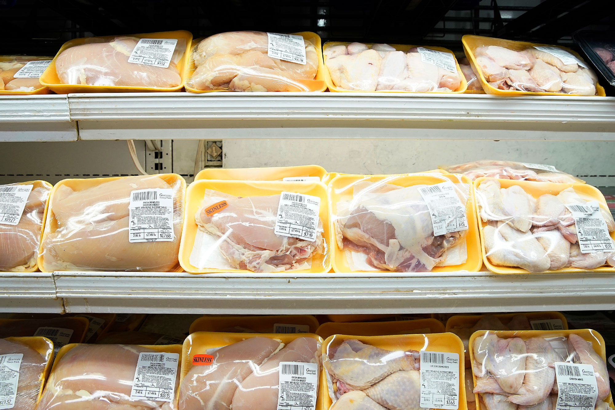 Poultry packages are seen in a supermarket refrigerator in