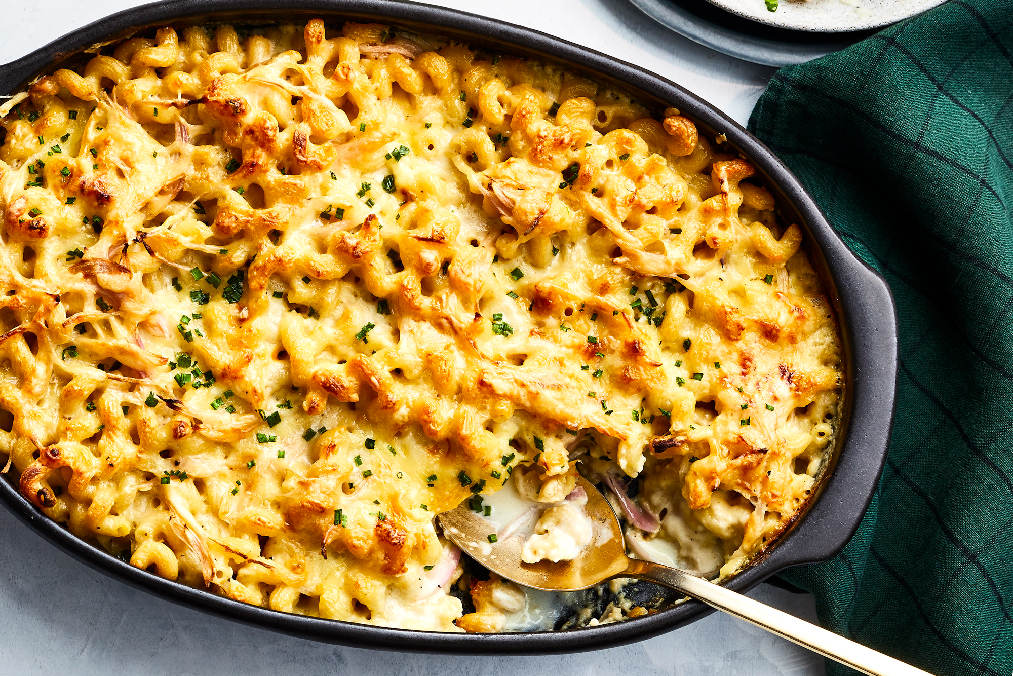 Raclette gruyere macaroni and cheese with pickled shallots