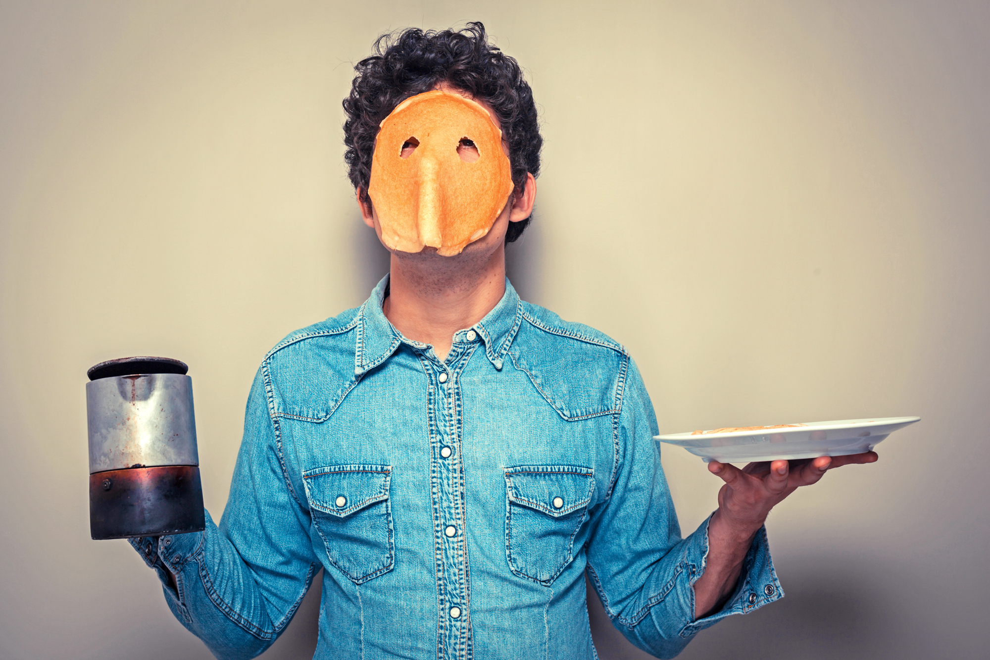 Server with pancakes on his face