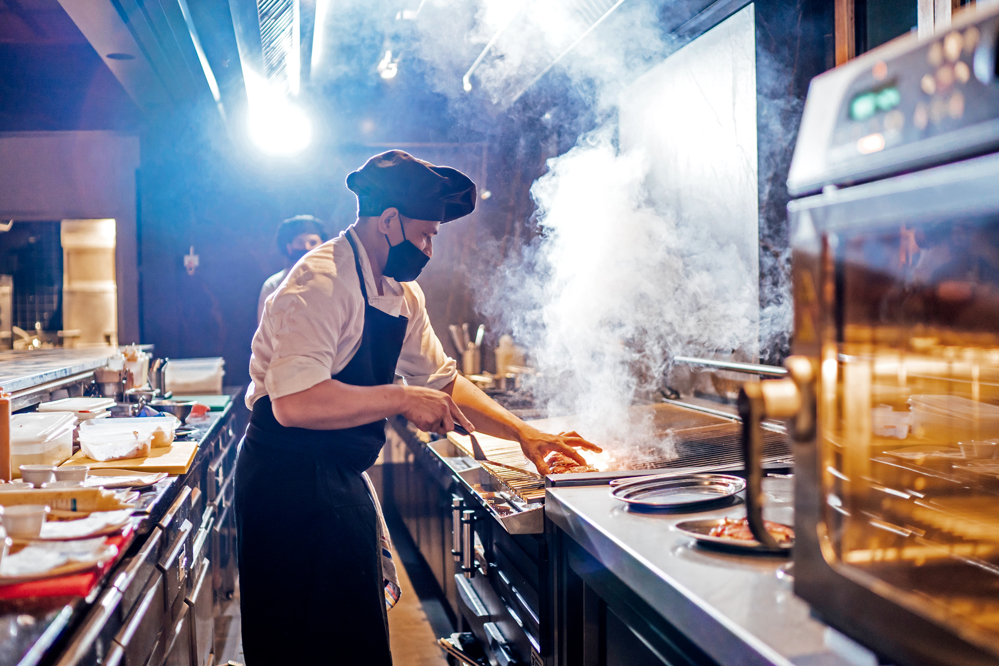 Masked restaurant worker