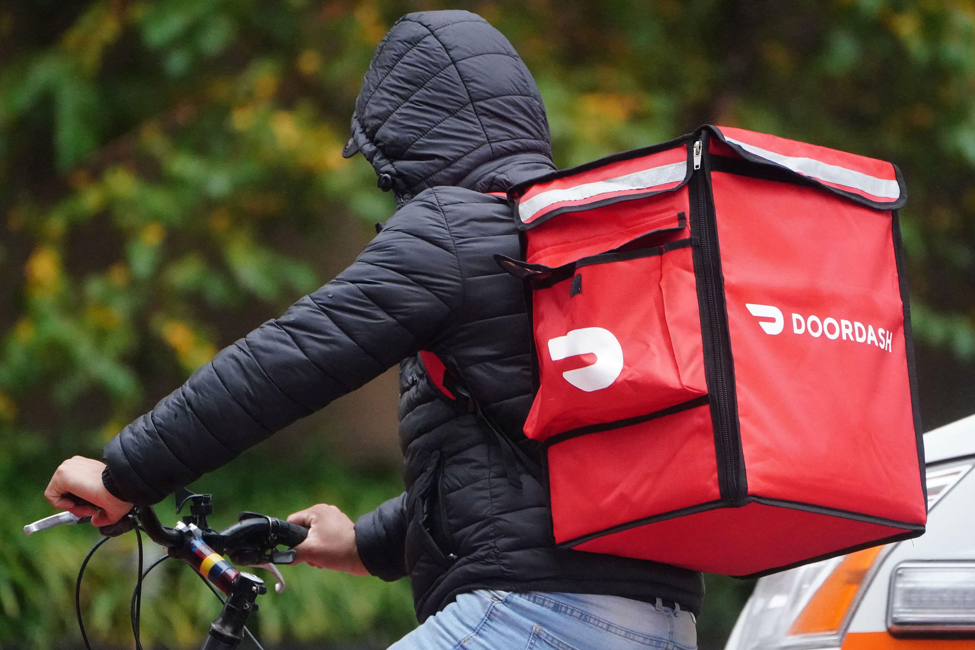 DoorDash delivery person on a bike