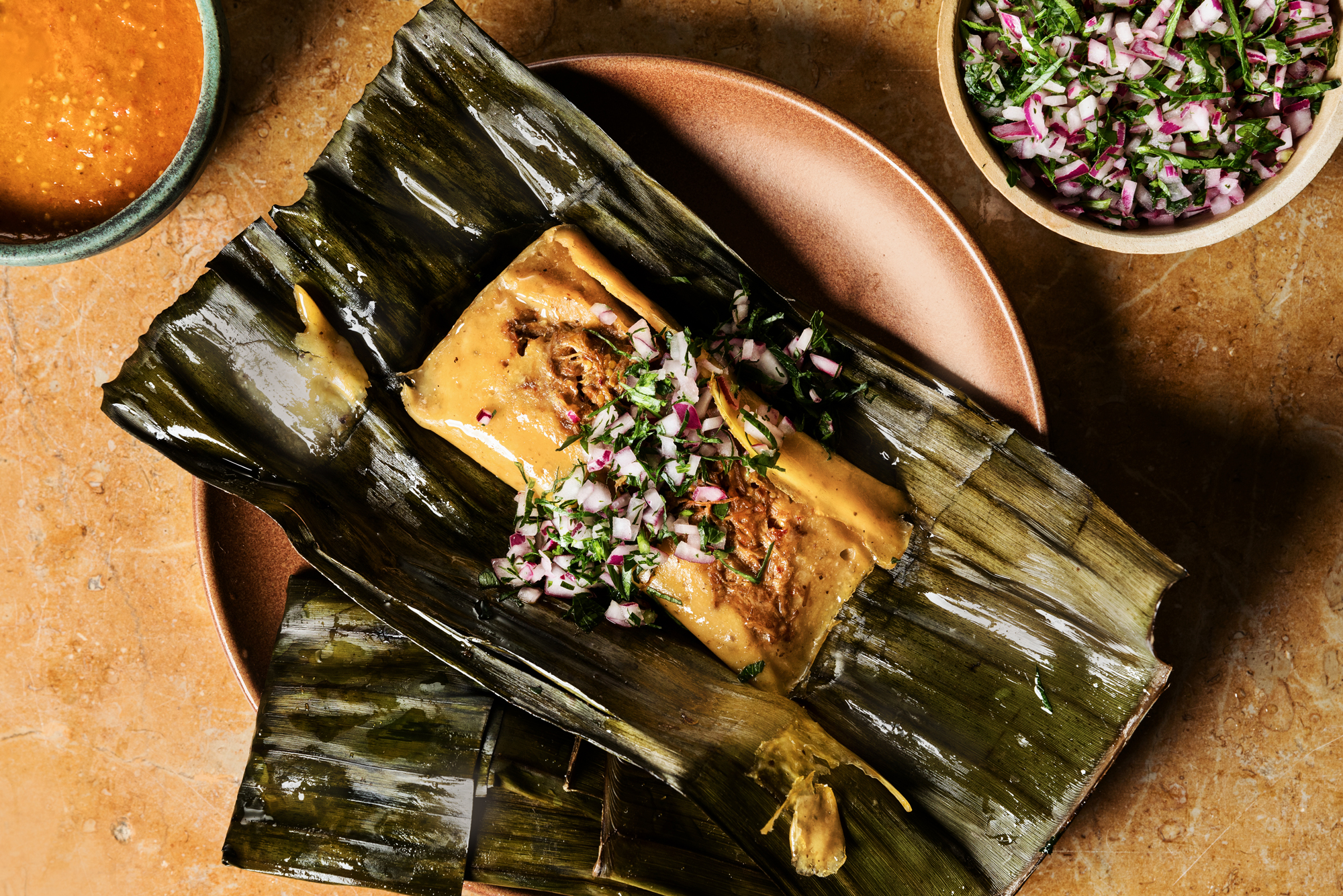 Banana Leaf Wrapped Lamb Shank Tamales with Morita Chile Salsa