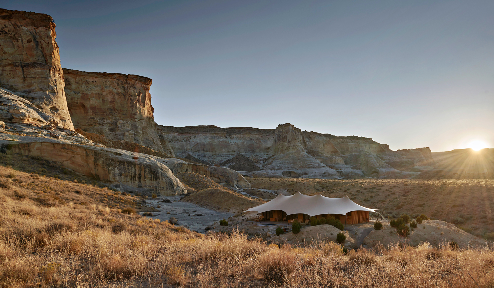 A natural backdrop sets off the luxe pavilions at Camp Sarika in Utah